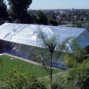 A house wrapped in a fire shield