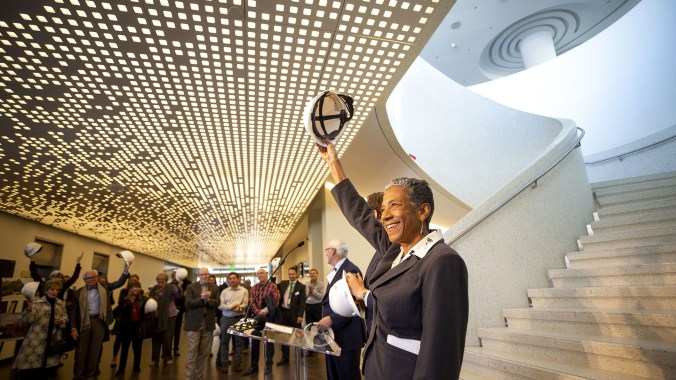 """Denver Deputy Mayor Allegra """"Happy"""" Haynes ceremoniously removes her hard hat as Denver Art Museum officials celebrate the end of their new Martin Building's construction phase and the start of their """"museum making"""" stage. Nov 13, 2019."""