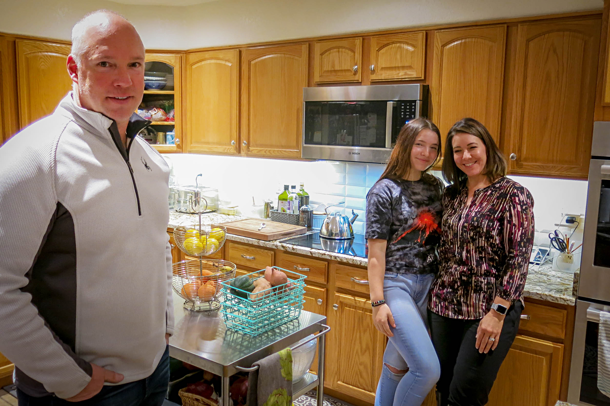State lawmaker Kevin Priola, his daughter Bremma and wife Michelle in the kitchen of their home in Henderson, Nov. 22, 2019.  The Priolas have struggled to figure out how to deal with their 17-year-old son who has developed a serious vaping habit.