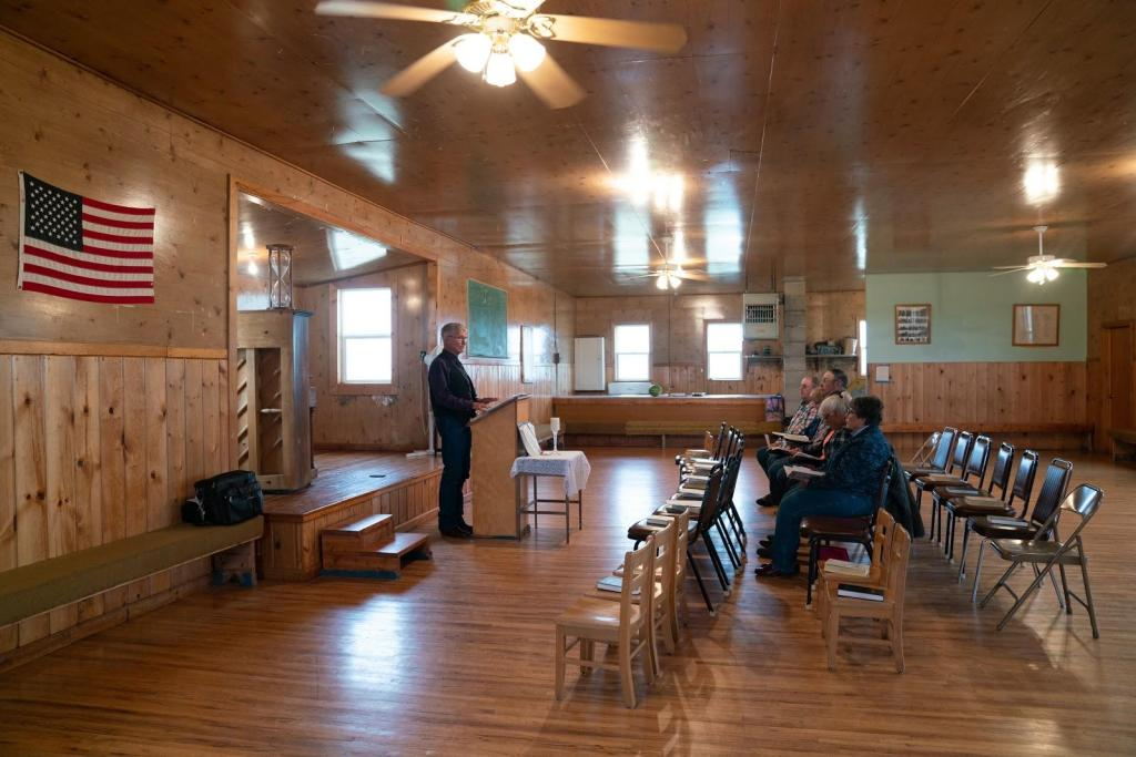"Pastor Hal DeBoer preaches to a small group of ranchers in northeastern Montana. The community is driven by the Christian notion of stewarding the land. ""[God] planted the Garden so he's for the farming profession,"" DeBoer said."