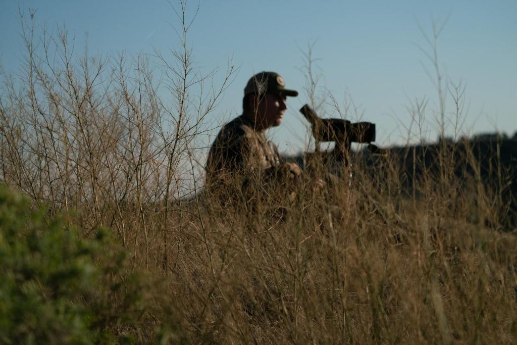 Hunter Justin Schaaf looks through a spotting scope on public lands that are part of the American Prairie Reserve, a sprawling wildlife sanctuary in northeastern Montana.