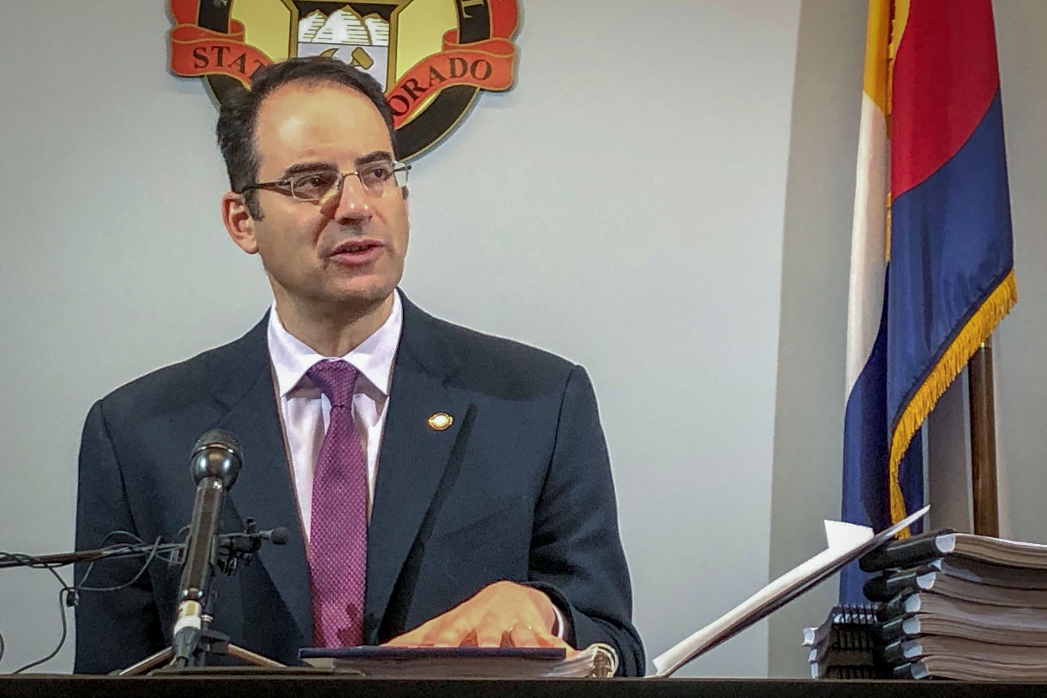 Colorado Attorney General Phil Weiser speaks in October 2019.