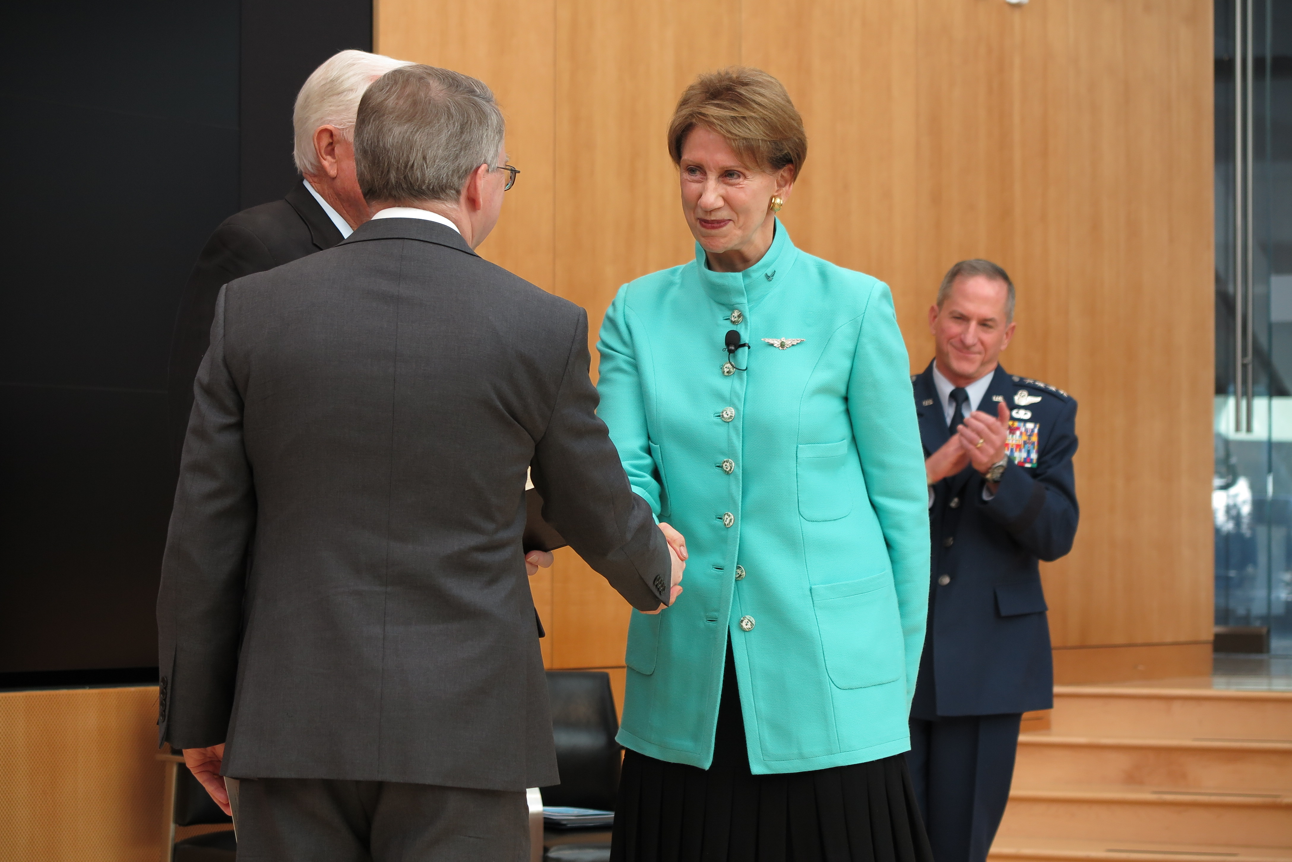 Air Force Secretary Barbara Barrett shakes hands with Deputy Secretary of Defense, David Norquist, after being sworn-in at the US Air Force Academy on November 2nd, 2019.