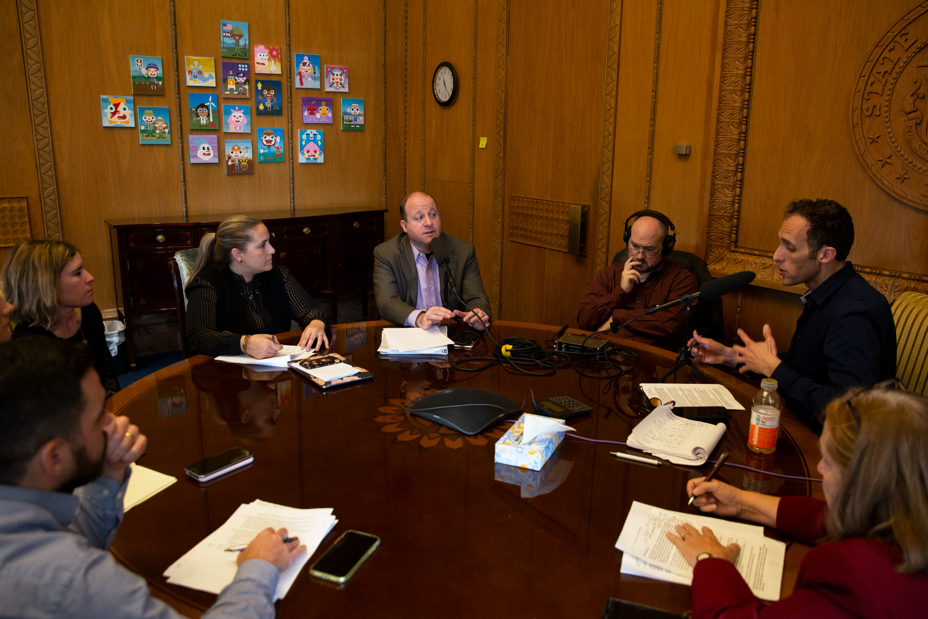 Gov. Jared Polis talks to Colorado Matters host Ryan Warner in his office at the state Capitol on Wednesday, Nov. 13, 2019.