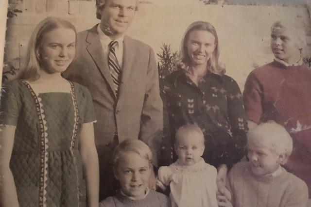 A family photo of the Godfrey family, with Andy and Mark in the bottom row.