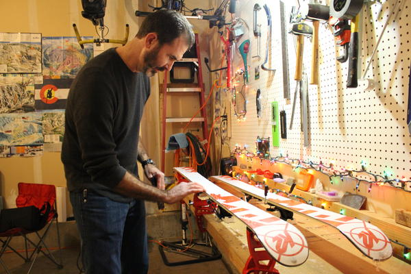 Avid skier Brian Varrella waxes his skis in his Fort Collins, Colo. garage.
