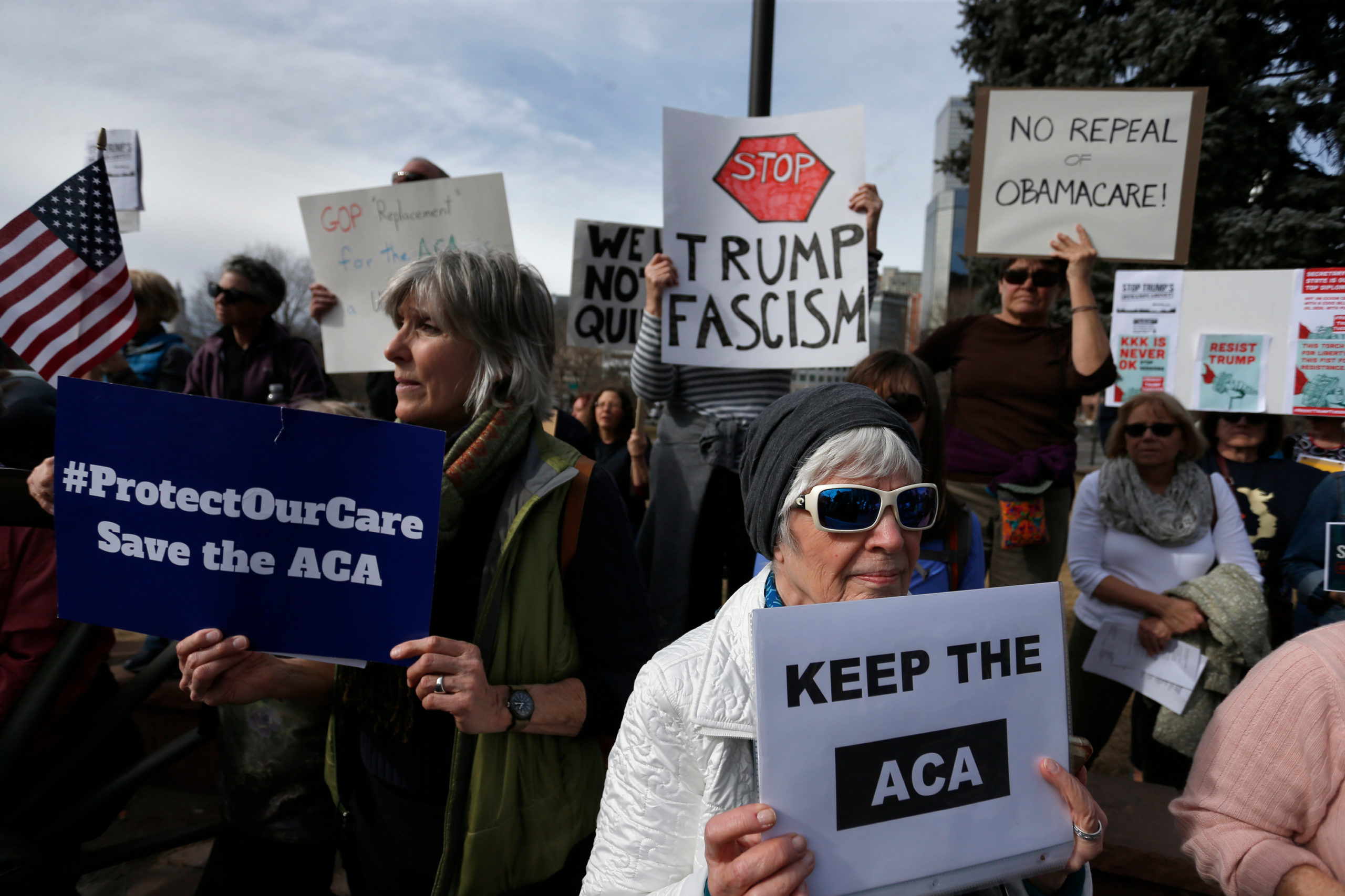 Supporters of the Affordable Care Act, who are also opponents of Colorado's GOP-led plan to undo Colorado's state-run insurance exchange, gather for a rally organized by the national Save My Care Bus Tour, on the state Capitol steps in Denver, Tuesday, Feb. 7, 2017.