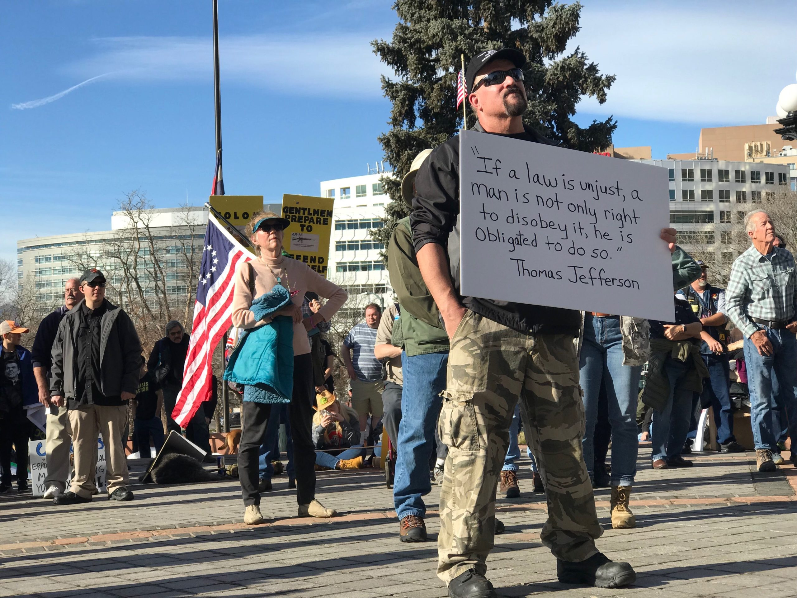 A man attend a gun rights rally at the Colorado State Capitol on Saturday, Dec. 7, 2019.