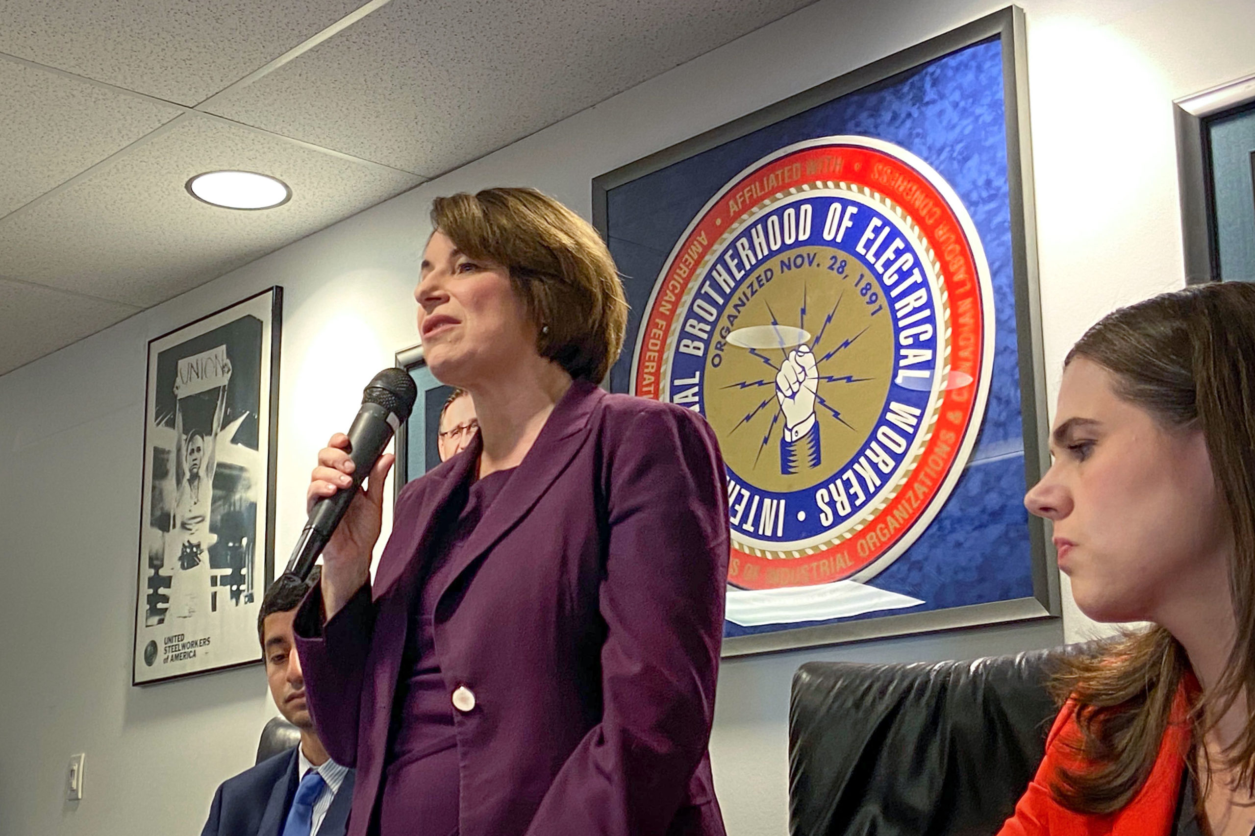U.S. presidential candidate and Minnesota Sen. Amy Klobuchar speaks at a Denver town hall held at the International Brotherhood of Electrical Workers Local 111 lodge in Park Hill, Dec. 8, 2019. Colorado Secretary of State Jena Griswold is to her left.