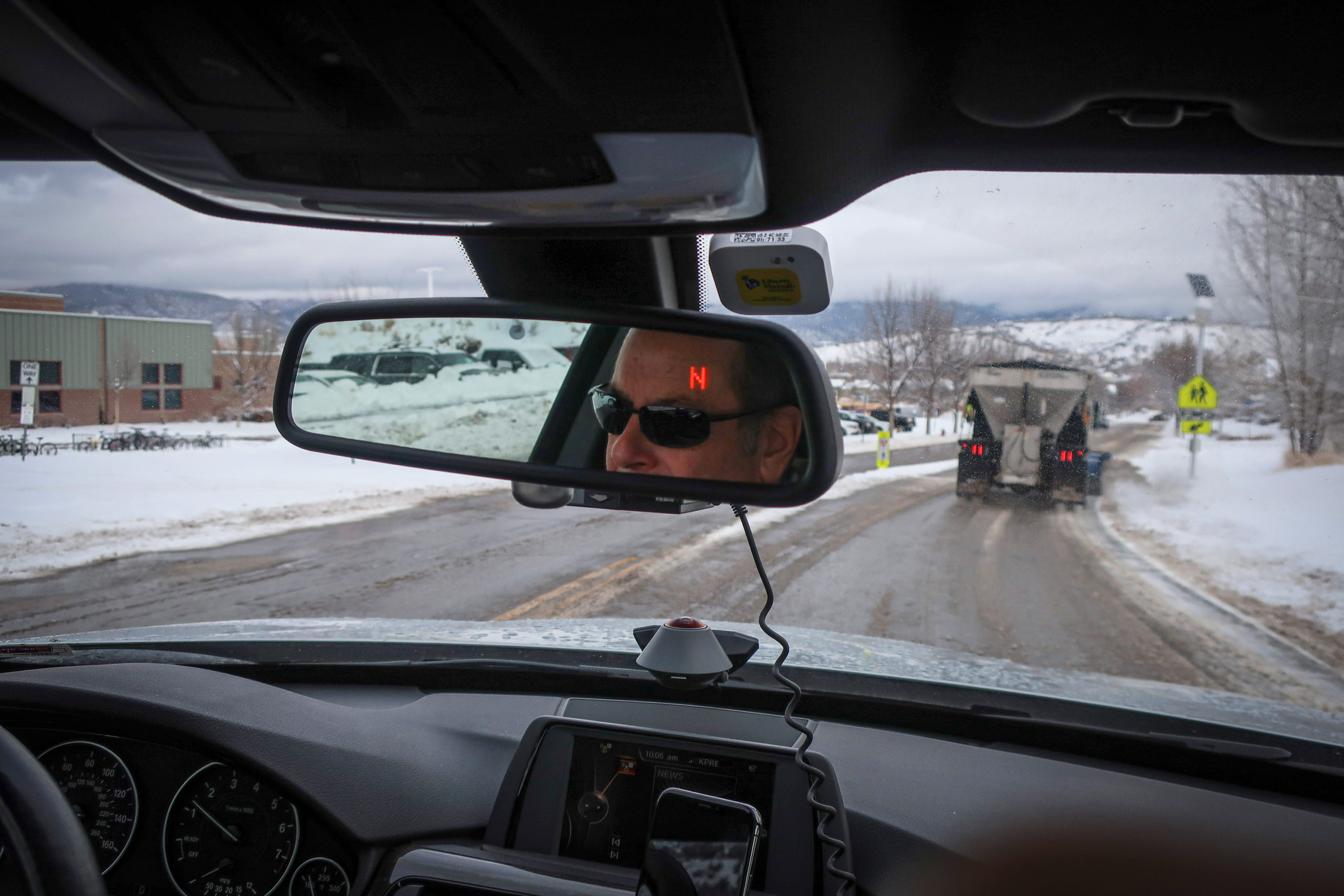 Colorado Wonders questioner and Edwards, Colorado resident Mark Bergman drives through Eagle, Colorado near county plows on Thursday, Dec. 5, 2019.