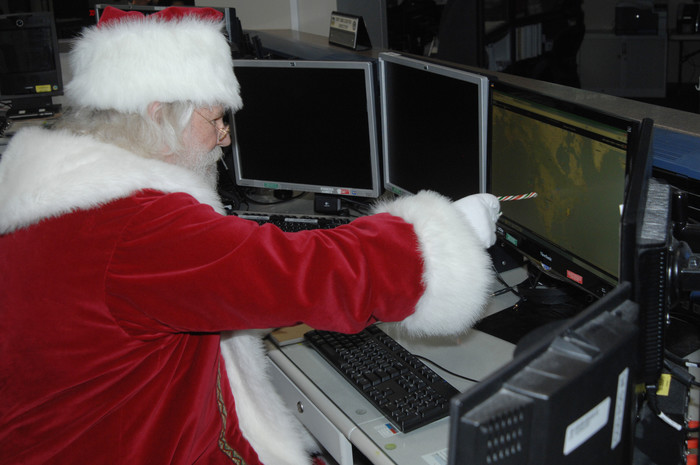 File photo. Santa Claus reviews his flight plan for his Dec. 25 trek across the globe in the North American Aerospace Defense Command and U.S. Northern Command Current Operations Center t the NORAD and USNORTHCOM headquarters at Peterson Air Force, Colo.