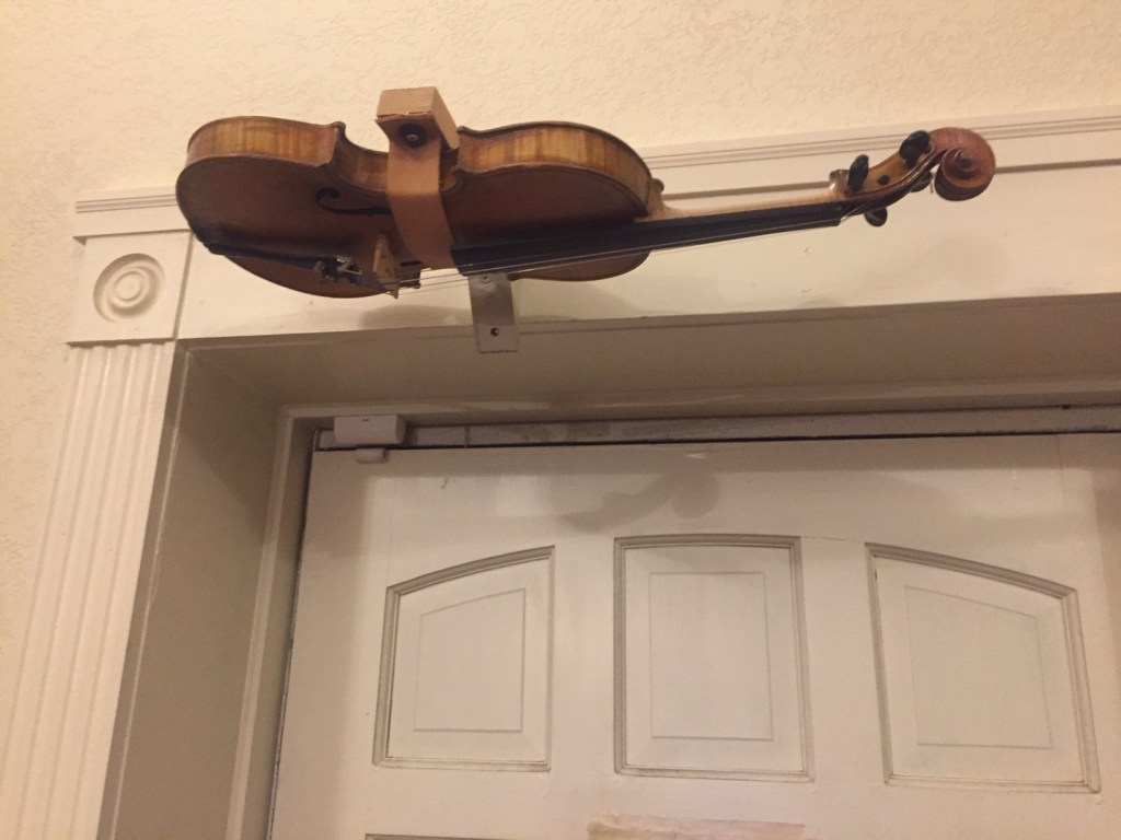 A violin above the doorway serves as the entrance chime.