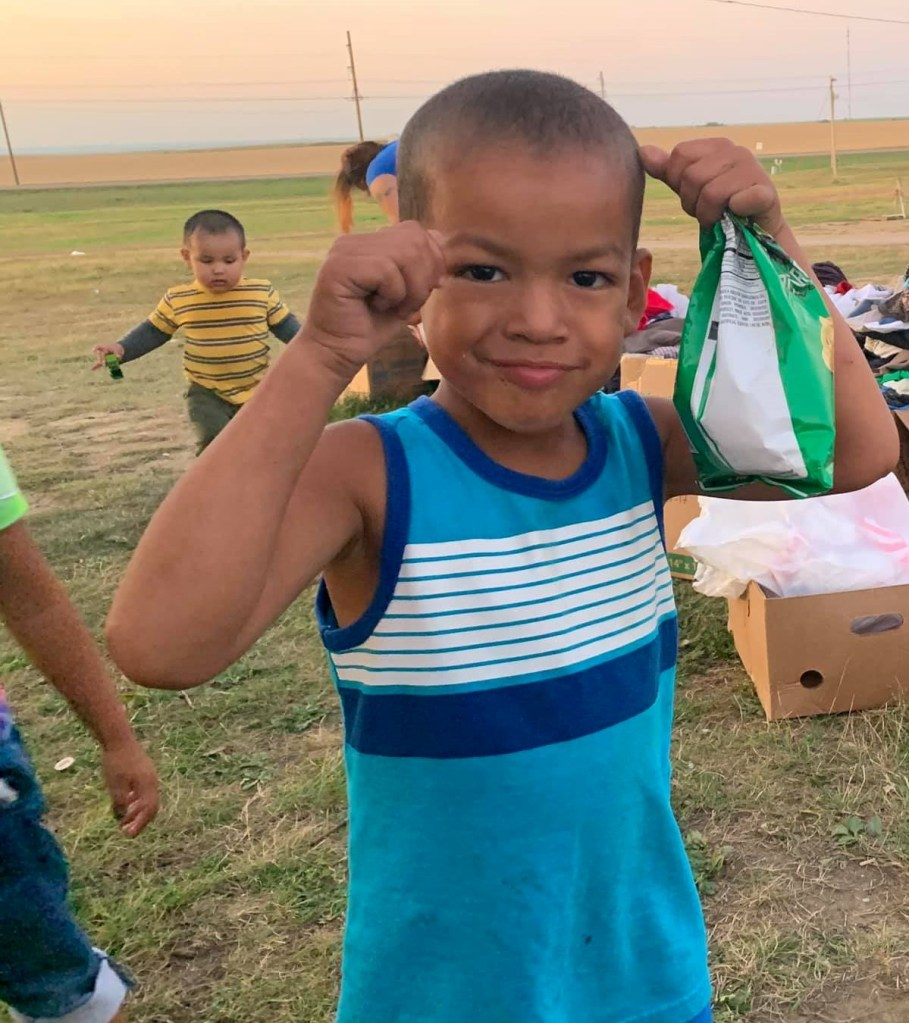 Smiles on the Rose Bud Reservation after receiving gifts.