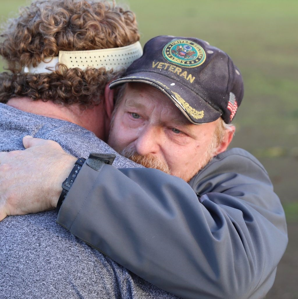 Woody Faircloth of  Denver, left, runs a nonprofit that donates RVs to people left homeless by the 2018 wildfire in Paradise, California. He's seen here hugging one of the people who received an RV.
