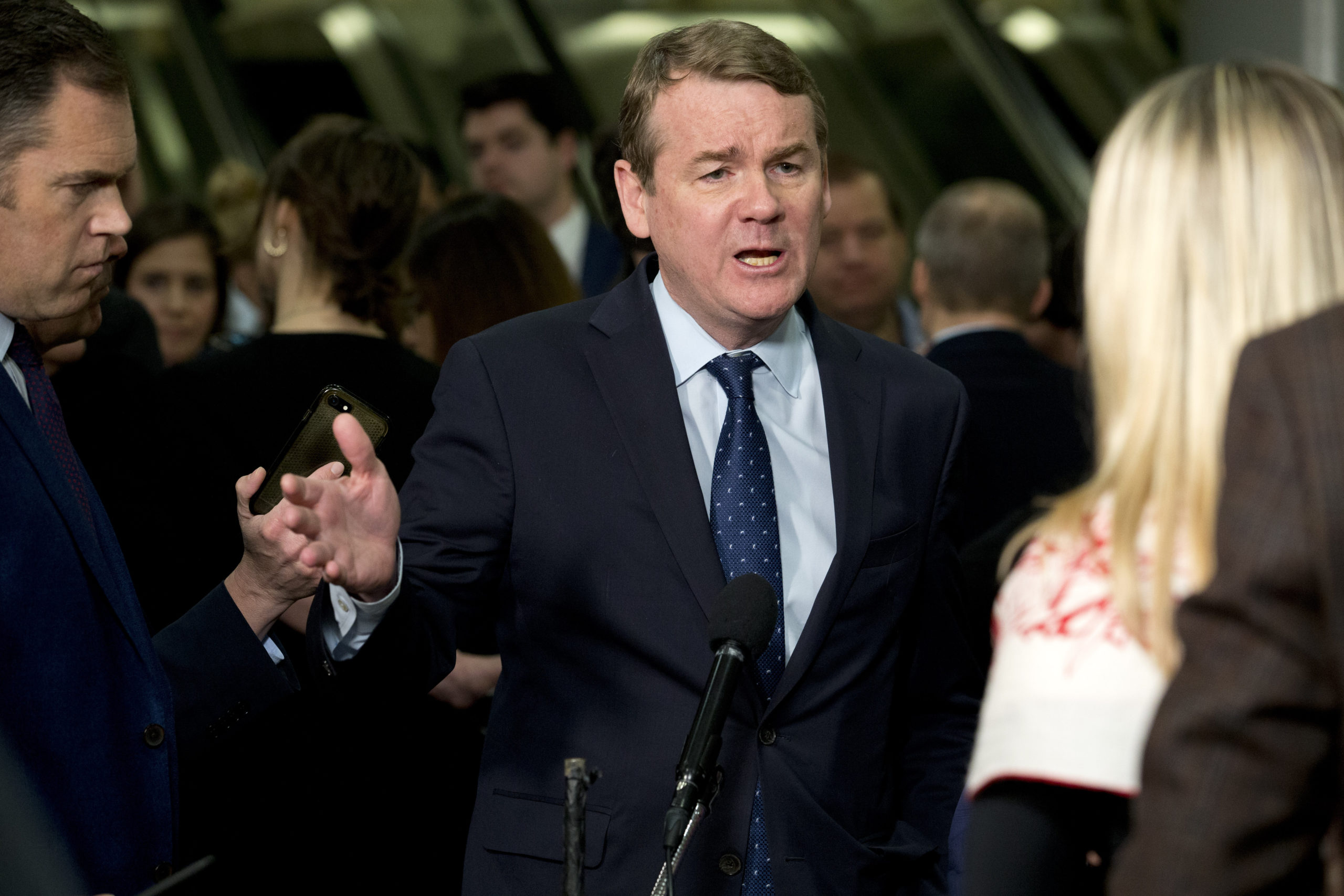 Sen. Michael Bennet, D-Colo., speaks to the media on Capitol Hill in Washington, Thursday, Jan. 23, 2020.