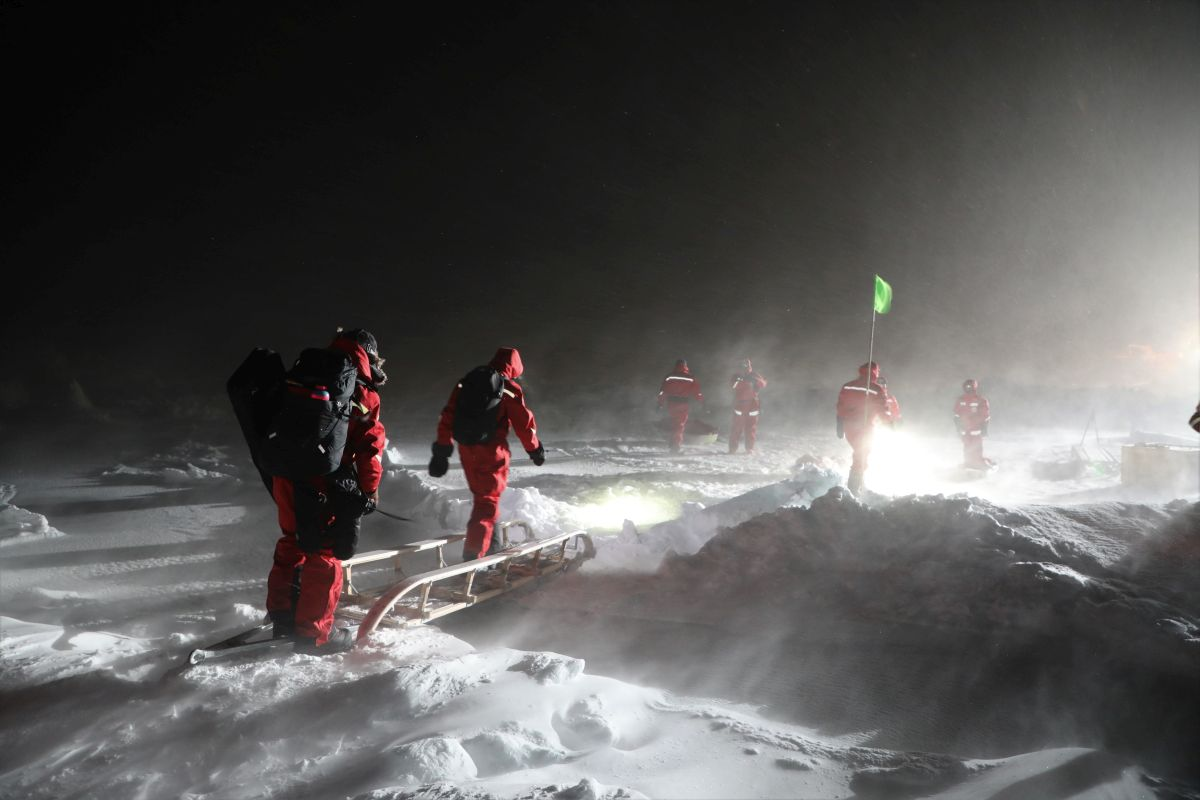 A day in the life of scientists and researchers with MOSAiC walk across snow and ice in the Arctic in 2019.