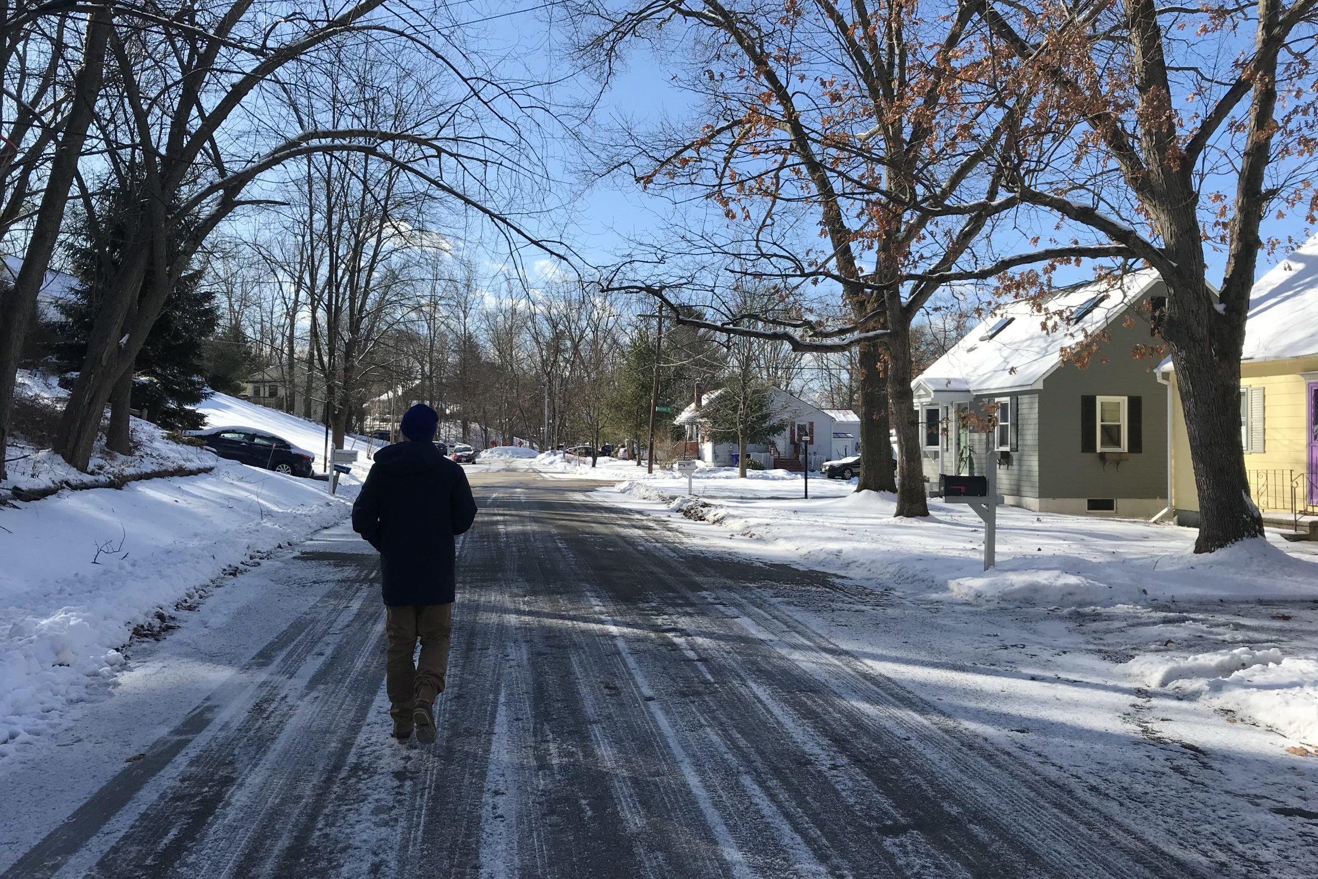 Brendan Powers walks to the next house on his list as he canvasses for Michael Bennet in Manchester, N.H.