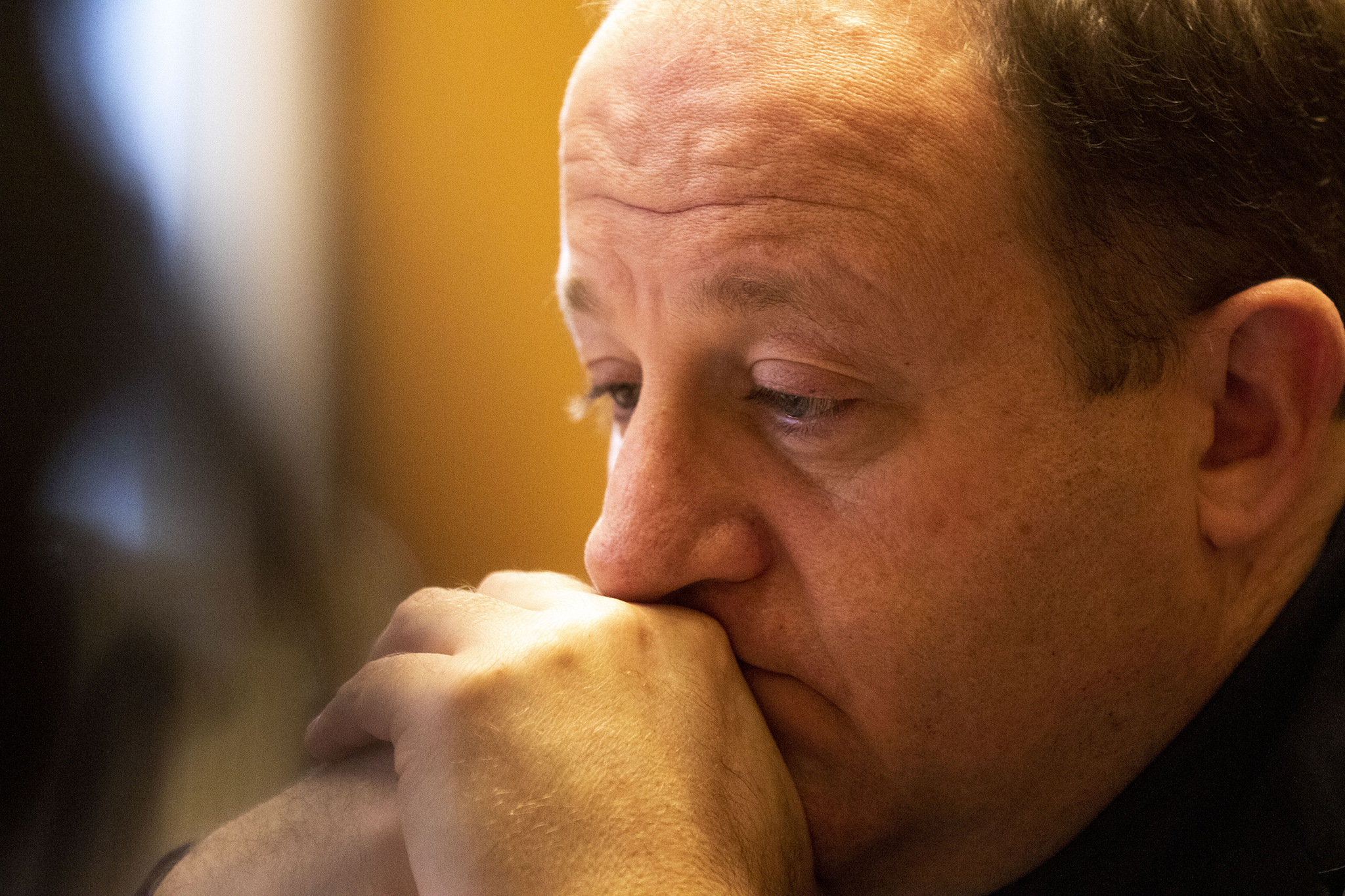 Gov. Jared Polis speaks to hundreds of clergy on a conference call about the COVID-19 crisis, March 19, 2020.