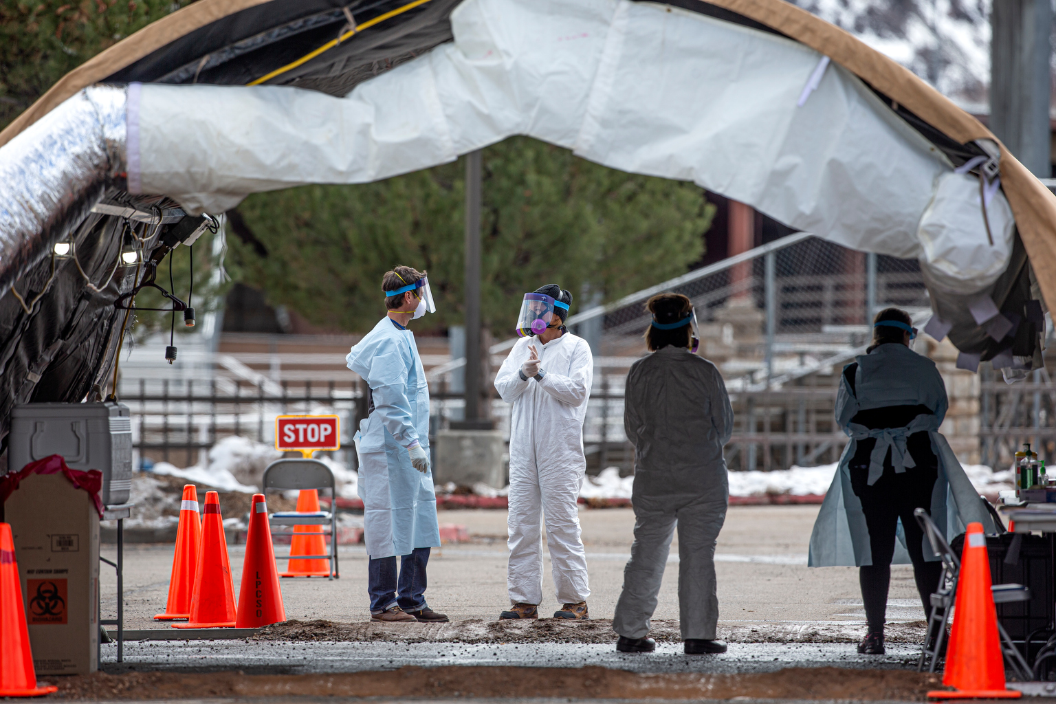 Medical personnel wait for the next patient to pull into the bay to be tested for the coronavirus during a drive through testing facility at the La Plata County fairgrounds Friday afternoon.