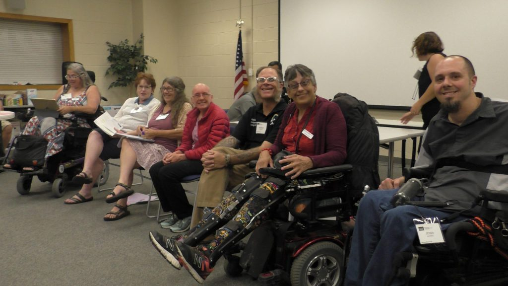 Kristen Castor (second from right) works as a non-attorney advocate with the Colorado Cross-Disability Coalition.