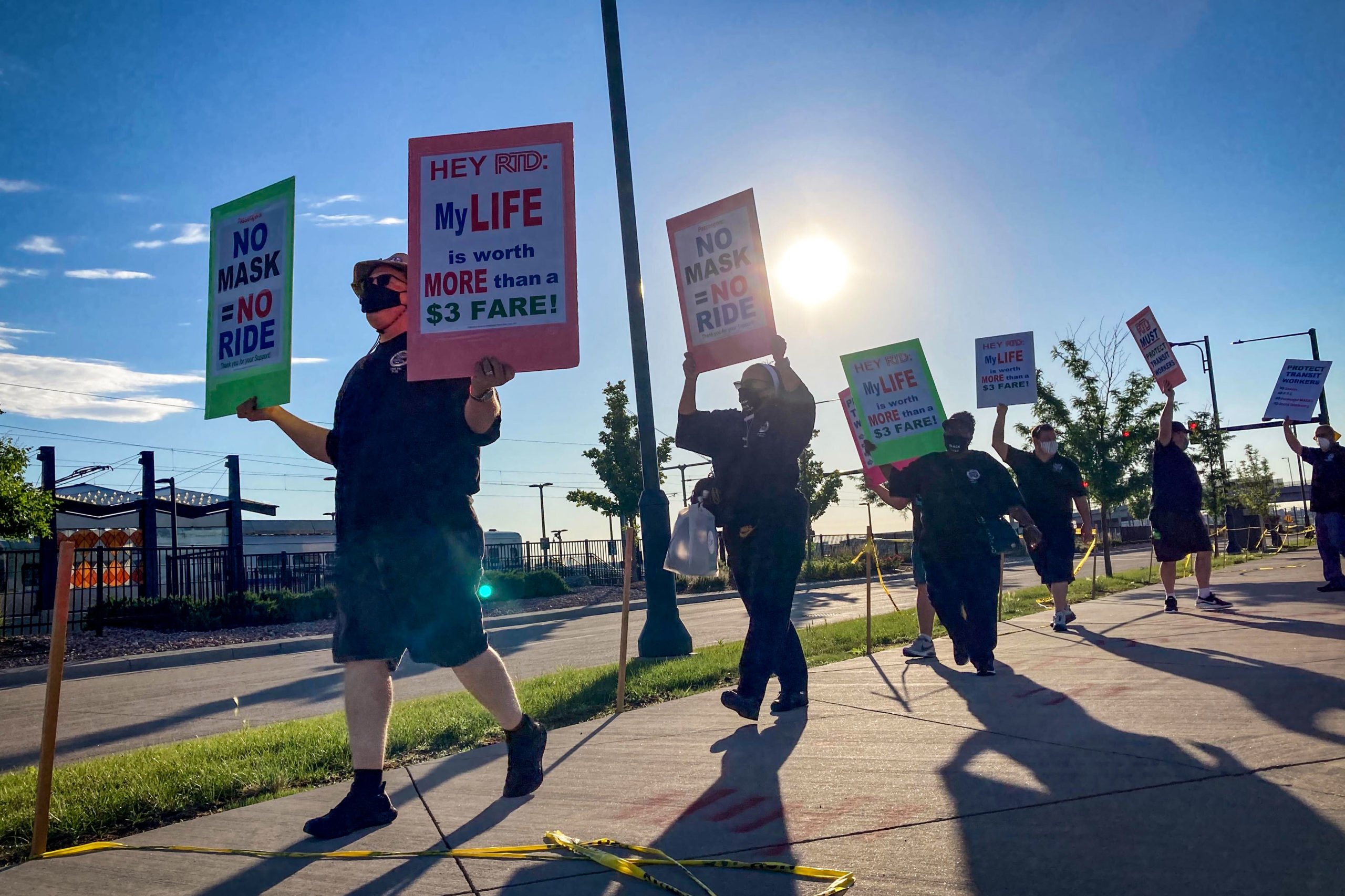 Union transit workers picket outside RTD's Central Park station, June 26, 2020.