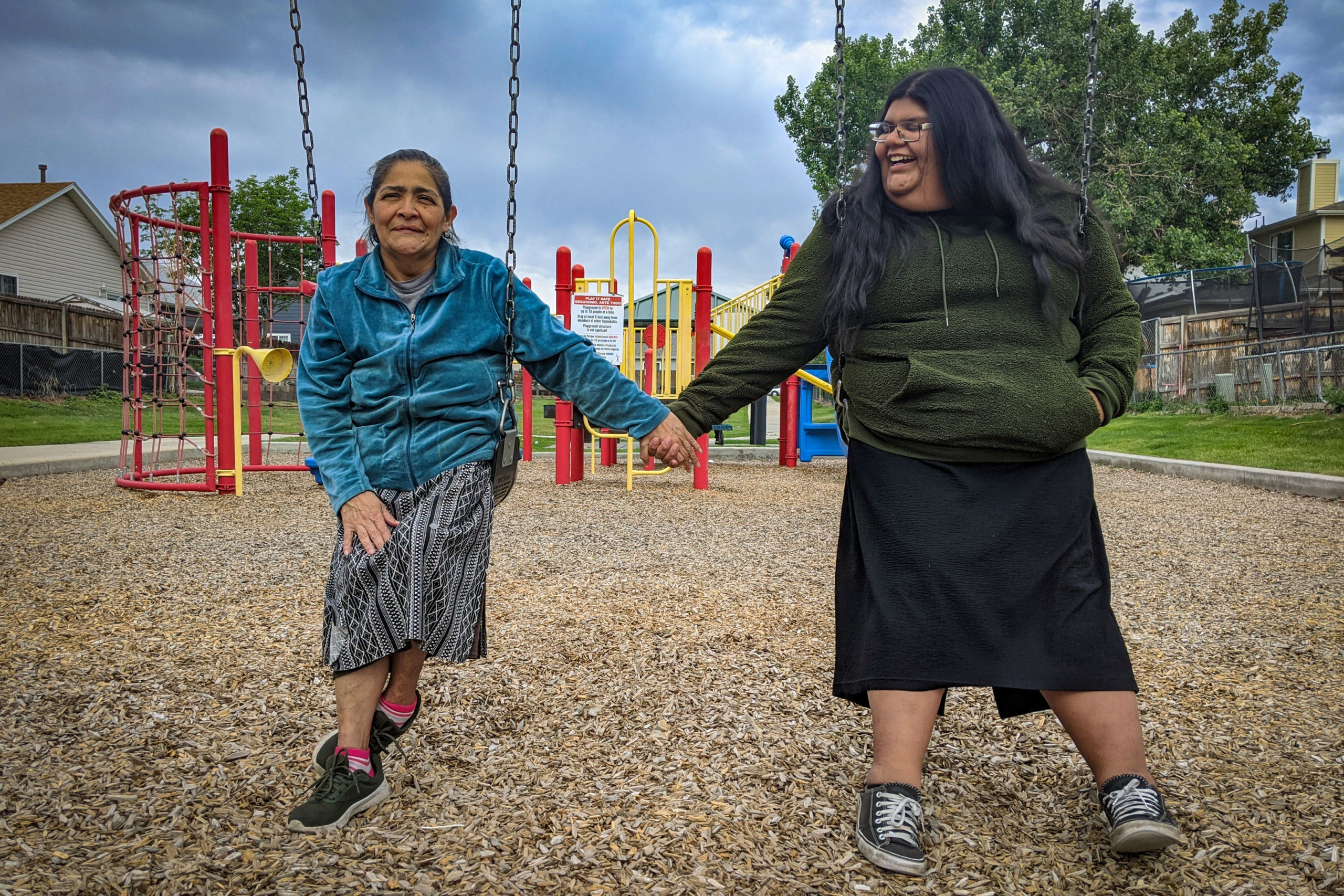 Katherine Aguilar poses with her mother, Holiday Aguilar, at a park near their home in Commerce City.