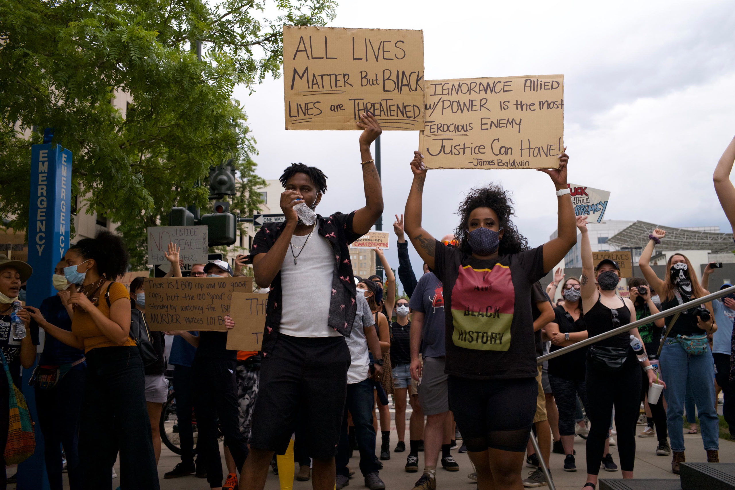 Hundreds of protesters march in Denver on Sunday, May 31, 2020.