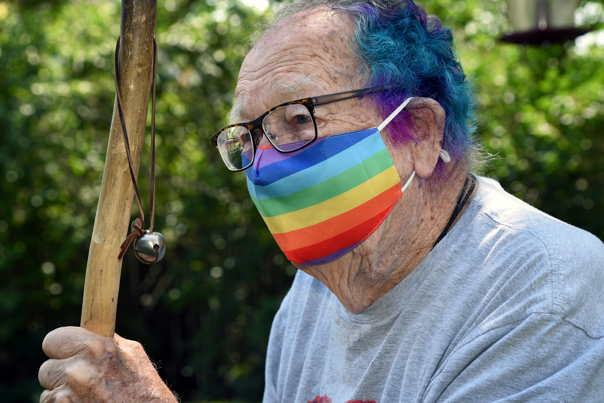 A friend dyed part of Ken Felts's hair blue and pink.  After a lifetime of dressing conservatively, he has a new array of rainbow clothing. It makes him happy to wear it.