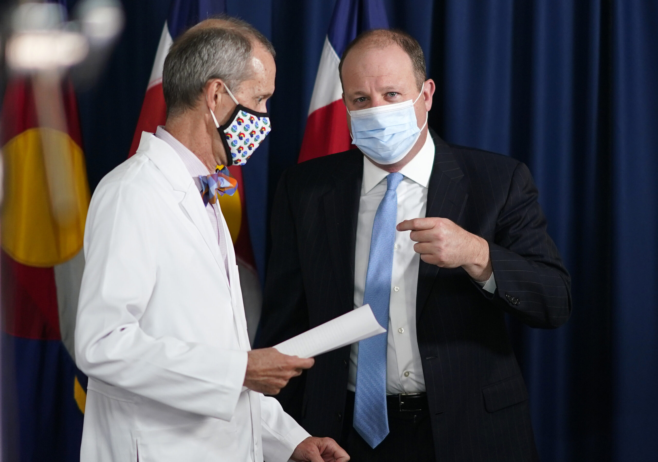 Gov. Jared Polis speaks with Dr. Eric France.