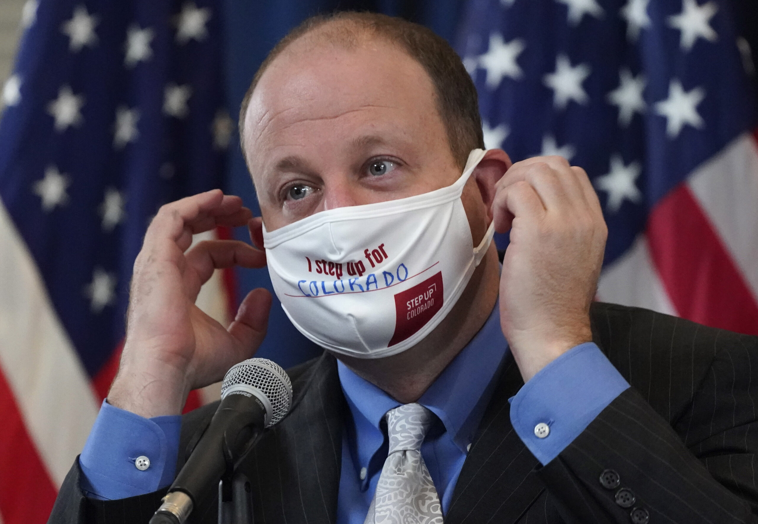 Jared Polis in a face mask.