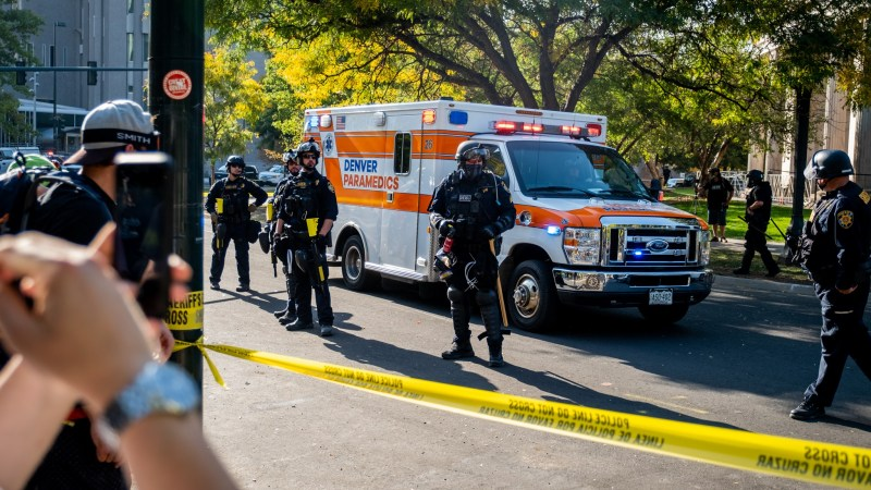 """An ambulance leaves the scene after a soup drive and """"anti-fascist"""" protest clashed with pro-police """"patriot"""" protestors, ending in one person being shot on October 10, 2020 at Civic Center Park."""