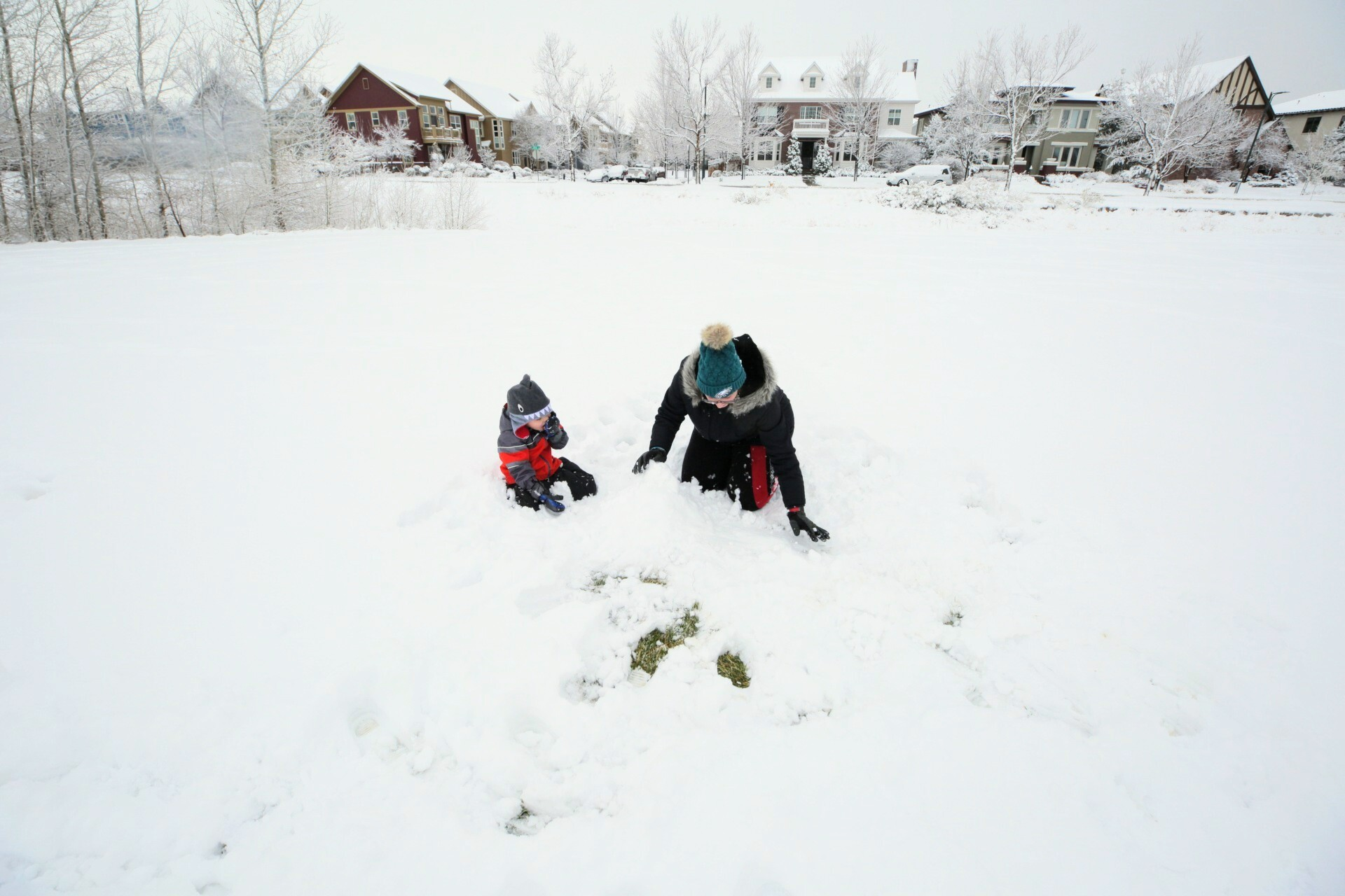 Foster, left, plays with his au pair, Ambar Tossolini, in GreenWay Park in Denver's Central Park neighborhood on Tuesday morning, Nov. 24, 2020.