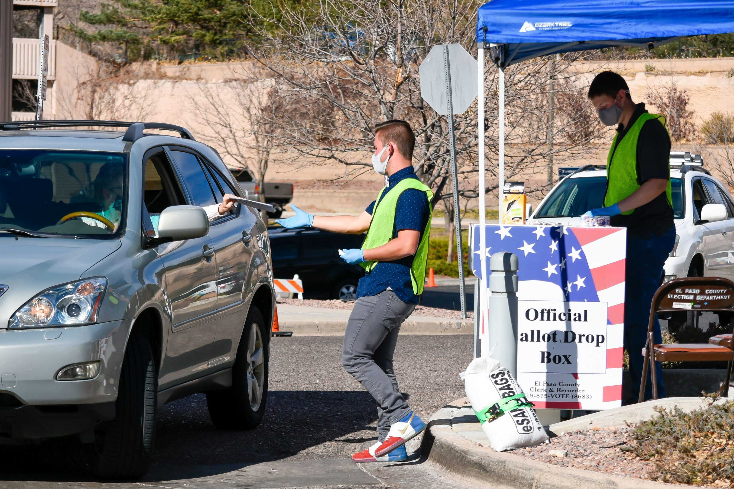Ben Hellen collects ballots at the Citizen Service Center on Garden of the Gods Road in the northwest part of Colorado Springs on Election Day 2020. A steady stream of vehicles kept them busy throughout the morning.