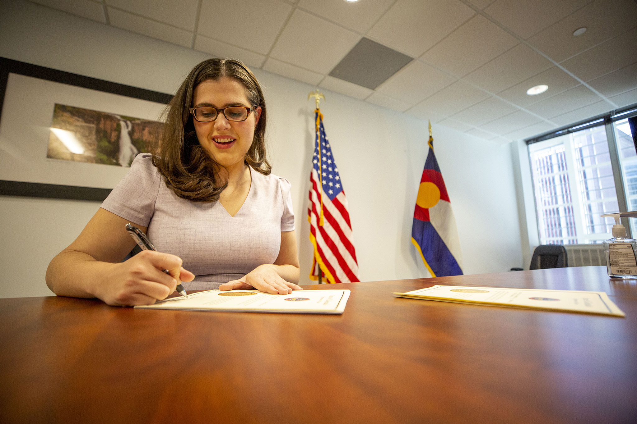 Secretary of State Jena Griswold certifies 2020 Colorado election results in a conference room near her office. Dec. 8, 2020.