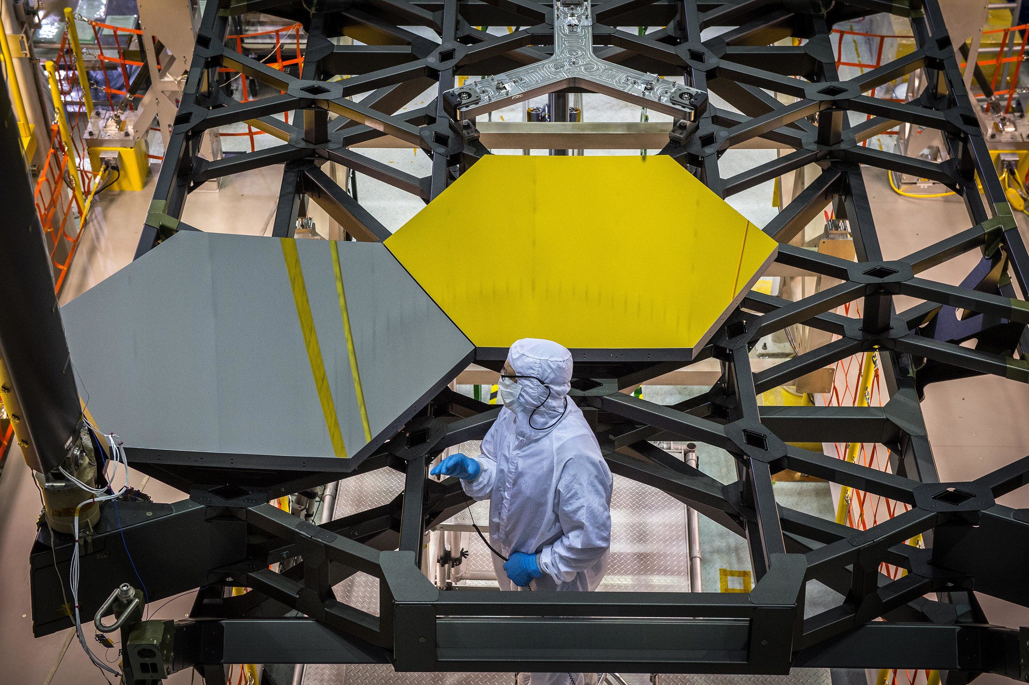 Scientists and engineers place two mirror segments on the NASA James Webb Space Telescope in 2014. The mirrors were built by Ball Aerospace and Technologies Corp. in Boulder.
