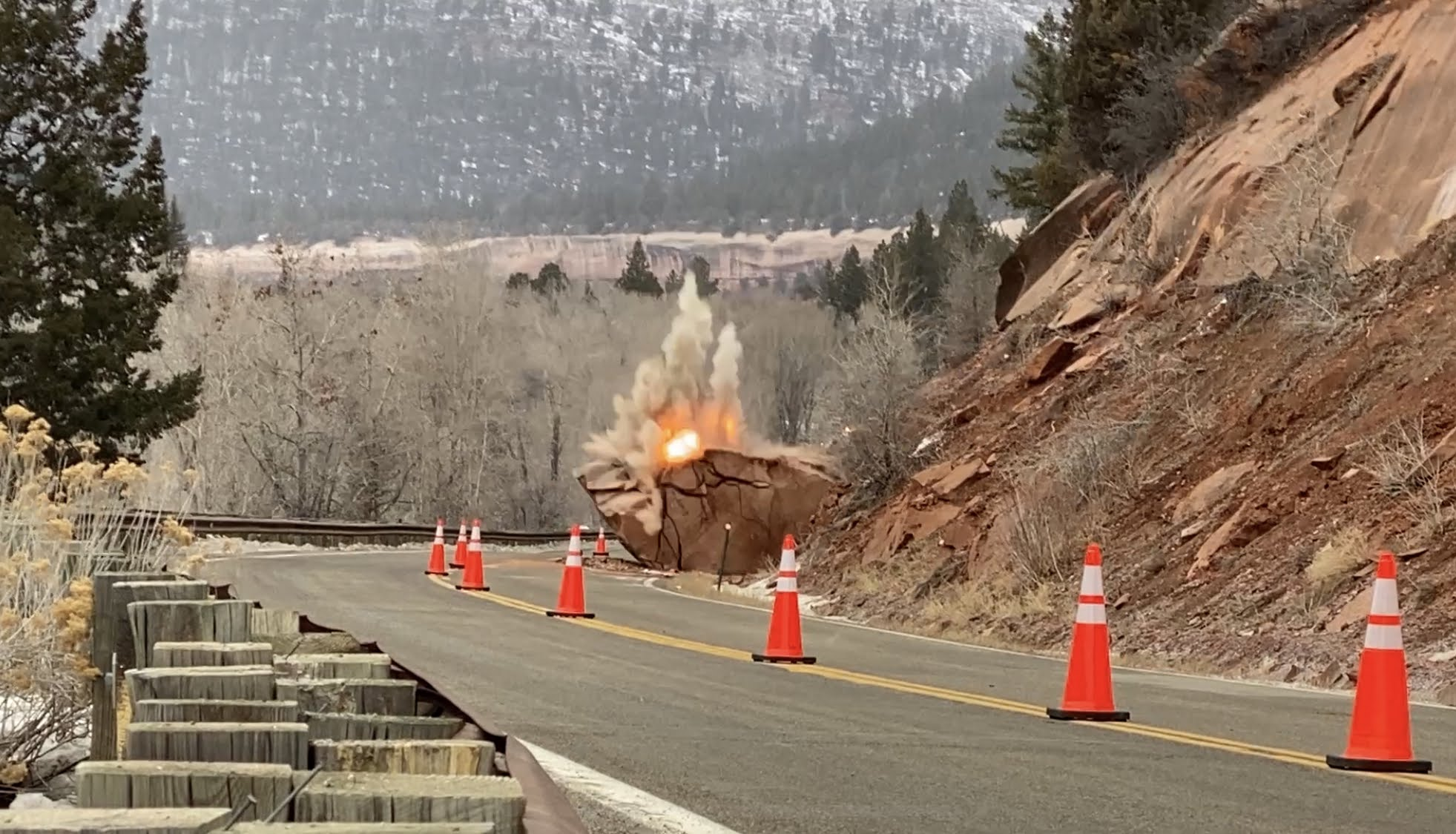 CDOT crews detonate explosives placed in a 200-ton boulder on Colorado Highway 145 south of Telluride on Friday, Feb. 5, 2021.