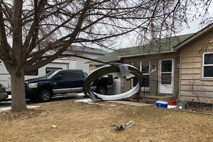 Engine debris from a United Airlines flight fell in the front yard of this home near 13th and Elmwood in Broomfield, Colo., Feb. 20, 2021.