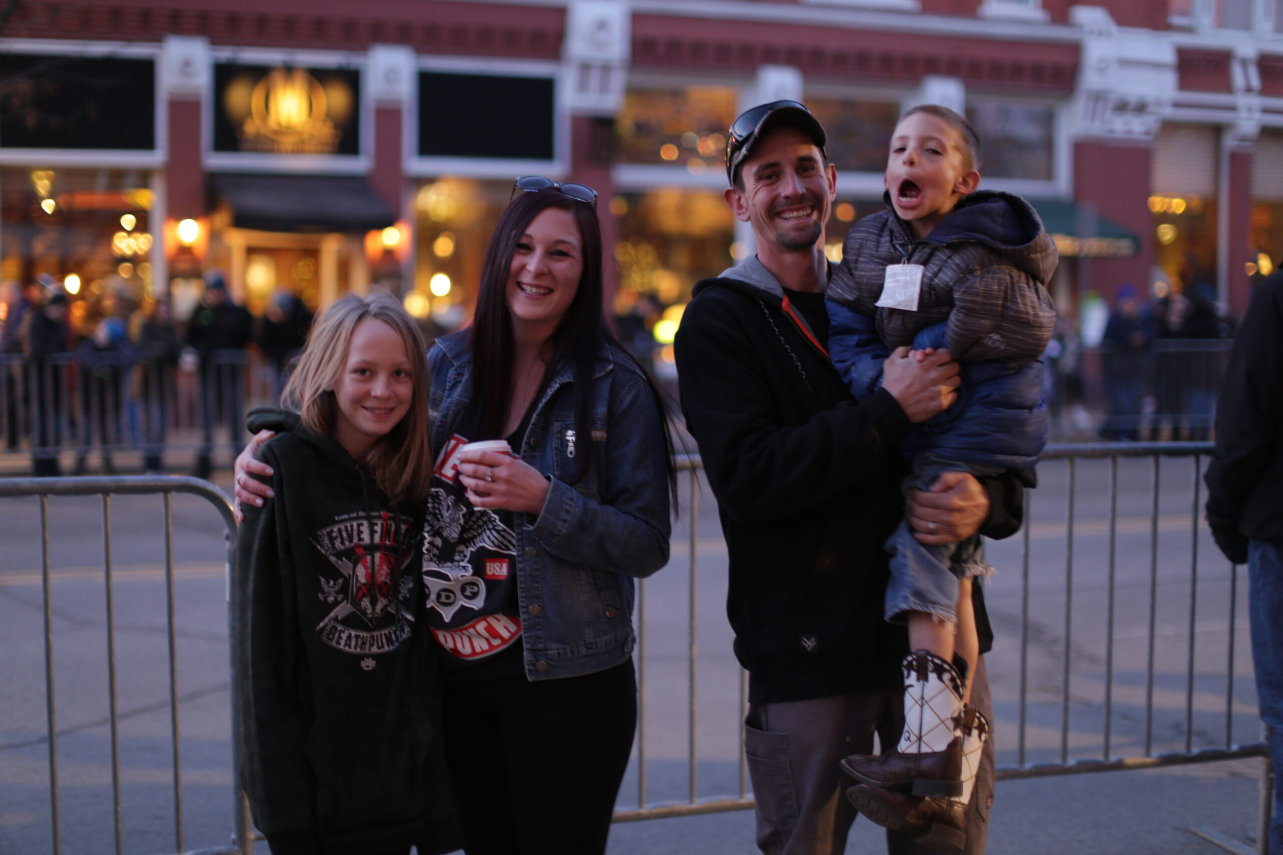 Steph Sherman and her family at Durango's Snowdown winter carnival, Jan. 29 - Feb. 2, 2020, pre-pandemic. Her youngest child makes silly faces as they wait for the parade to start.