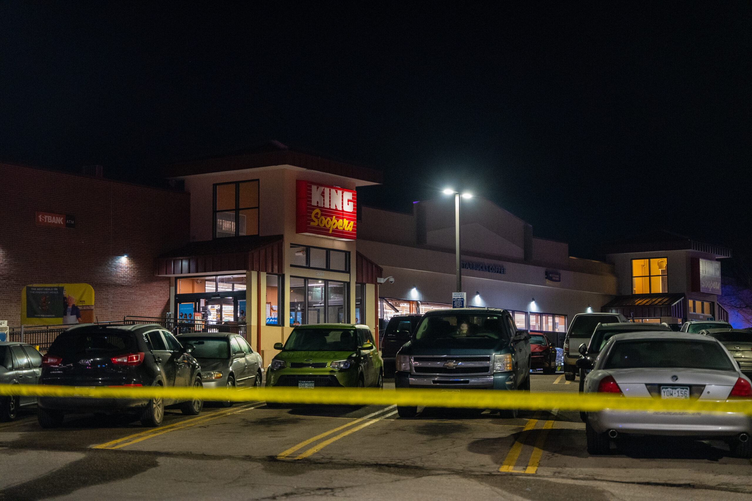 Police tape encircles the parking lot at King Soopers in Boulder, Colo., as police investigate the scene of the March 22, 2021 shooting that killed 10 people.