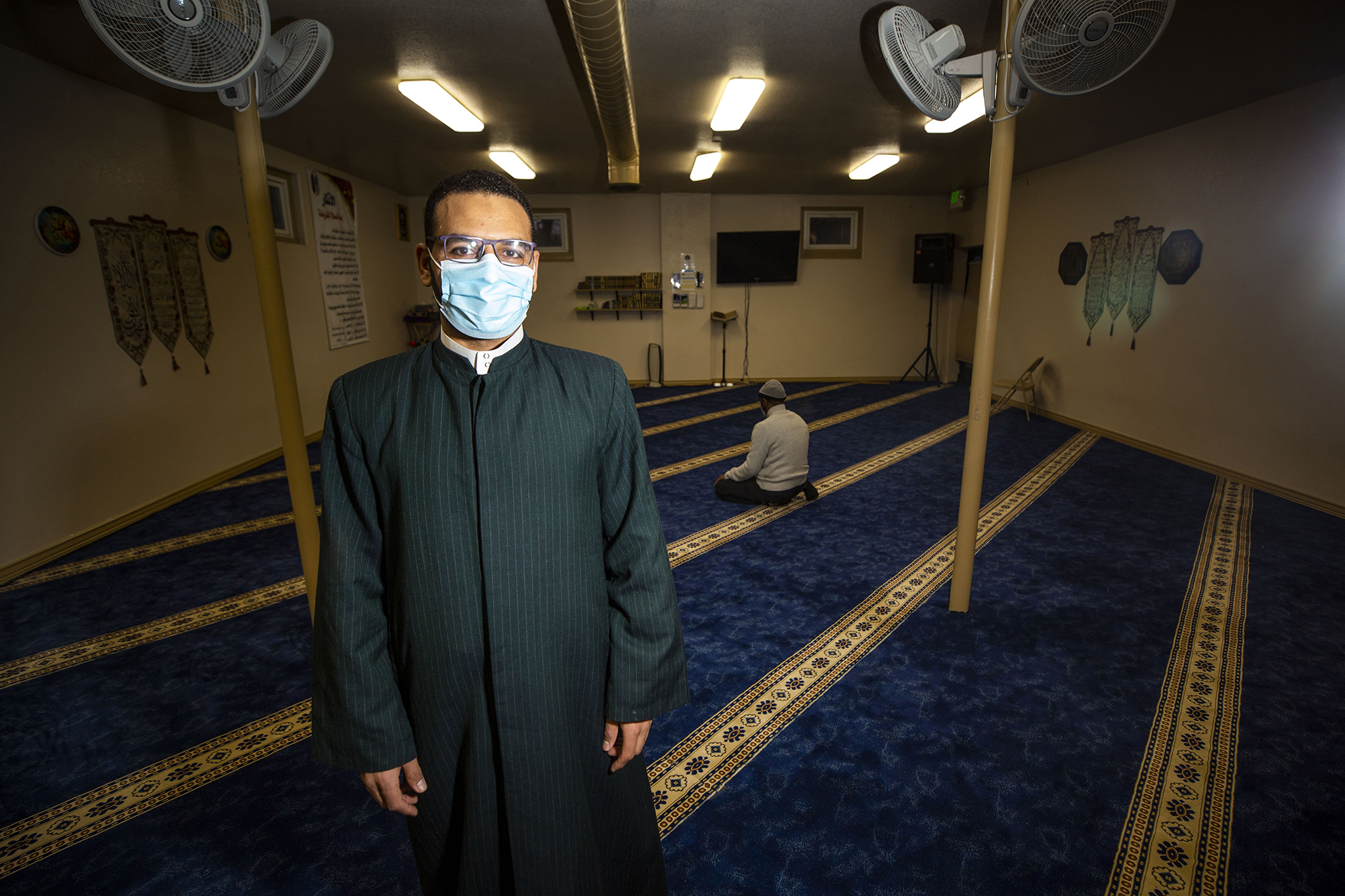Imam Muhammad Kolila stands in the Whittier's Downtown Denver Islamic Center before evening prayer. March 2, 2021.