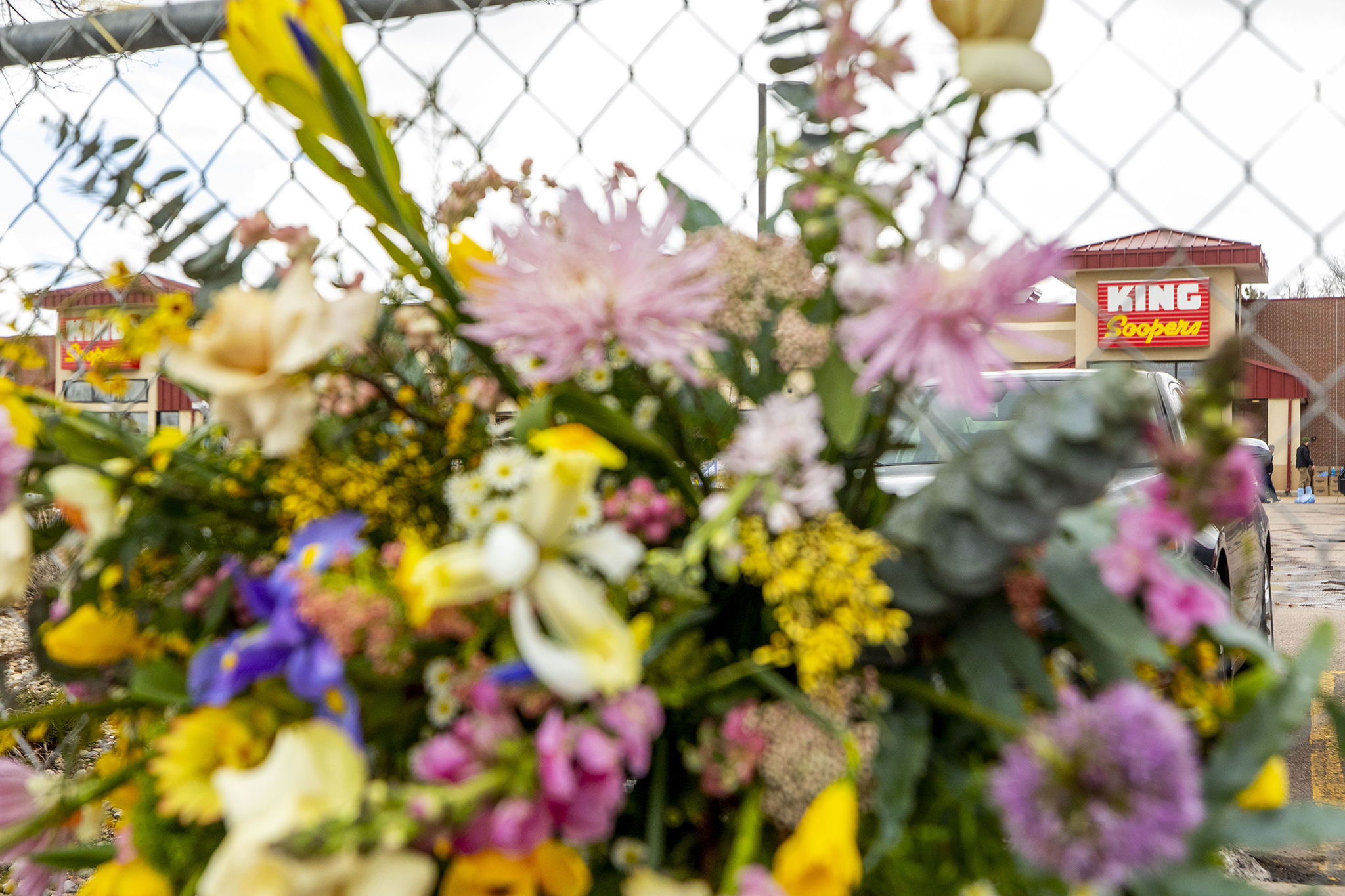 Hundreds of people visited the site of a mass shooting at a Boulder, Colo. King Soopers to leave flowers, cards and candles on March 23, 2021.