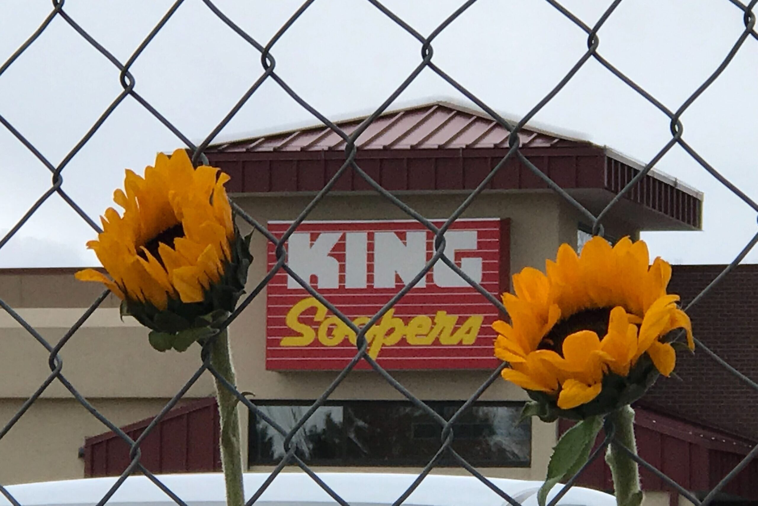 A makeshift memorial grew outside the blocked-off entrance to the Table Mesa King Soopers, March 23, 2021.