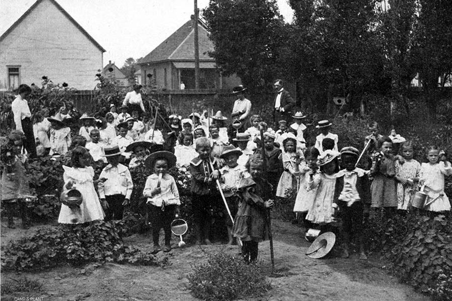 Superintendent of schools, J.F. Keating, Miss Carlile and children of Bessemer School working in their garden, Pueblo, 1902.