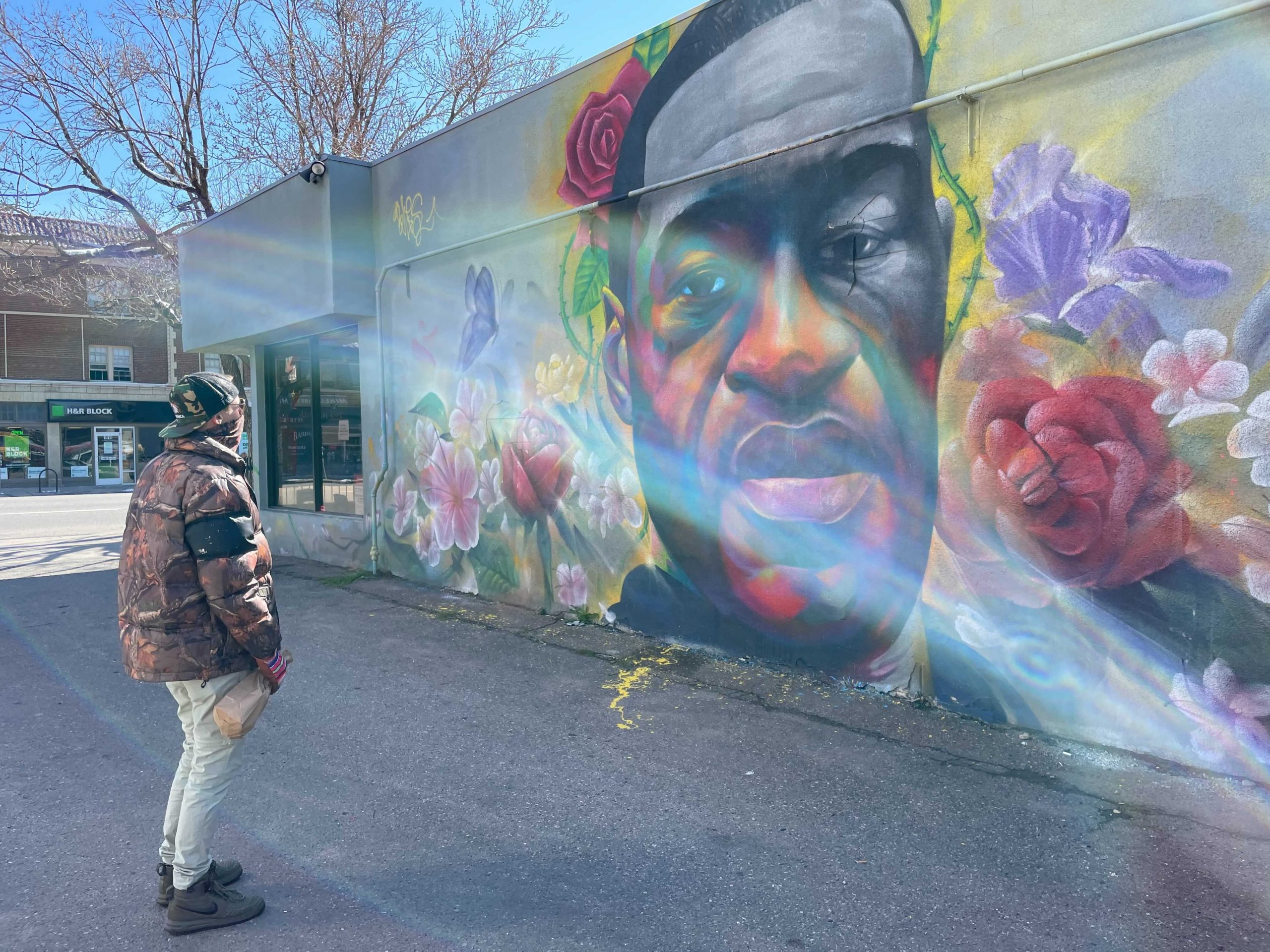 Colin Early stops by the George Floyd mural on Colfax Ave. near downtown Denver after hearing that Minneapolis police officer Derek Chauvin was found guilty on three counts of murder in the 2020 killing of George Floyd.