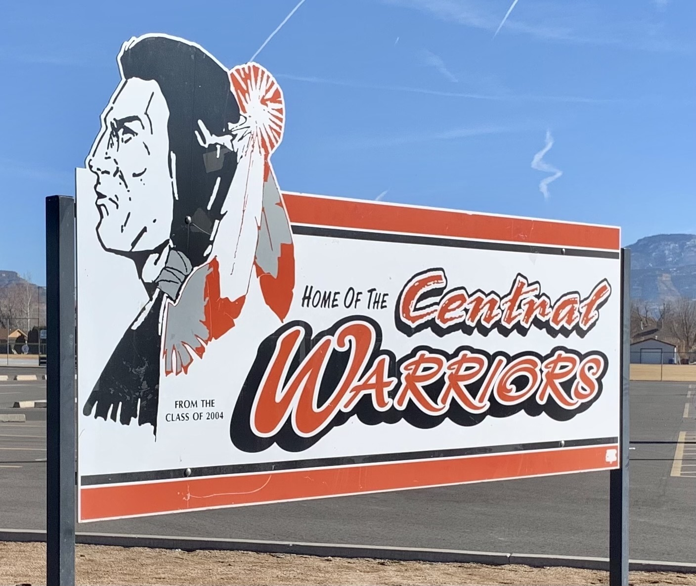 A sign depicting Grand Junction Central High School's soon-to-be-former mascot stands at the school.