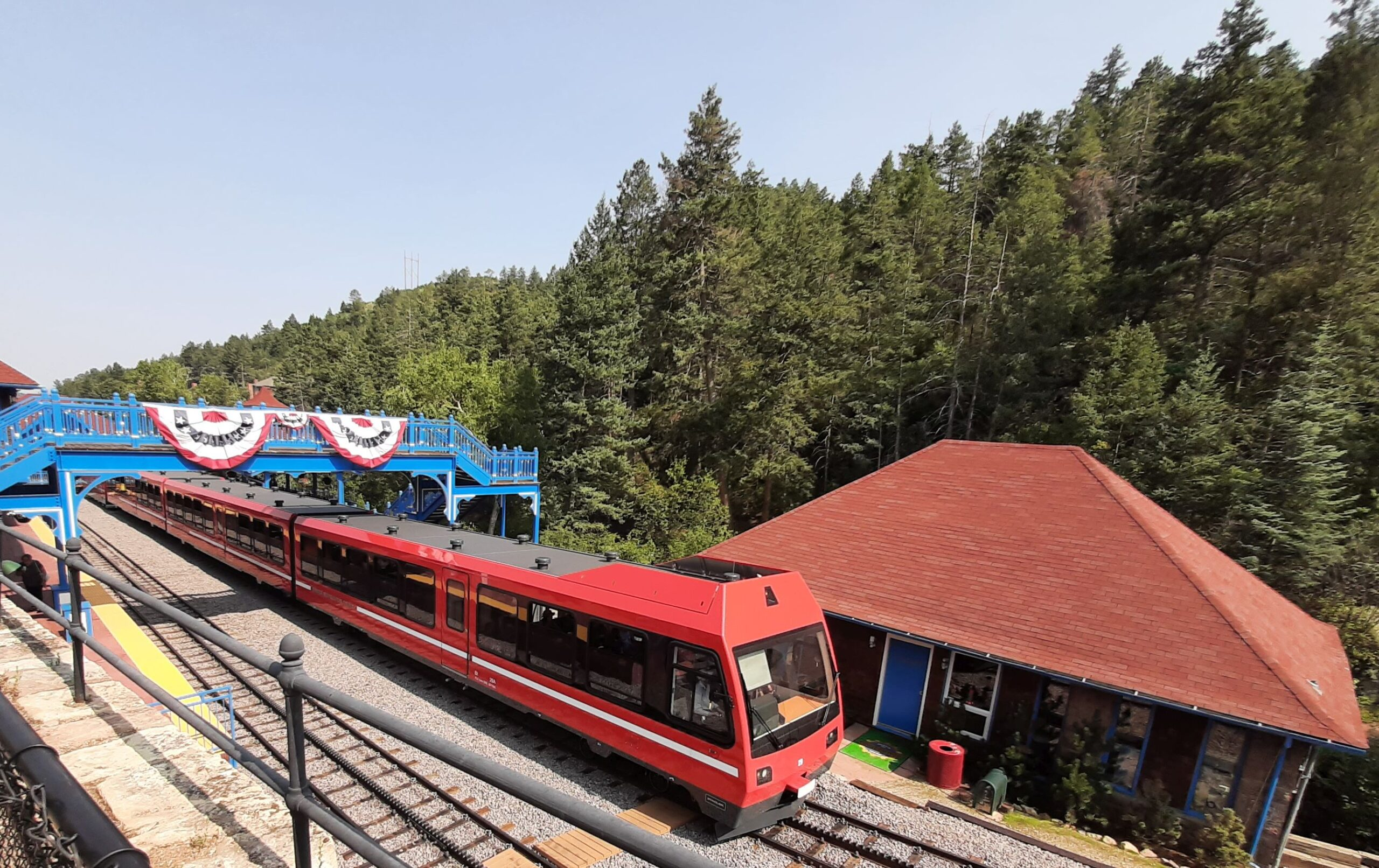 The Pikes Peak Cog Railway takes passengers from Manitou Springs up to the summit of the mountain.