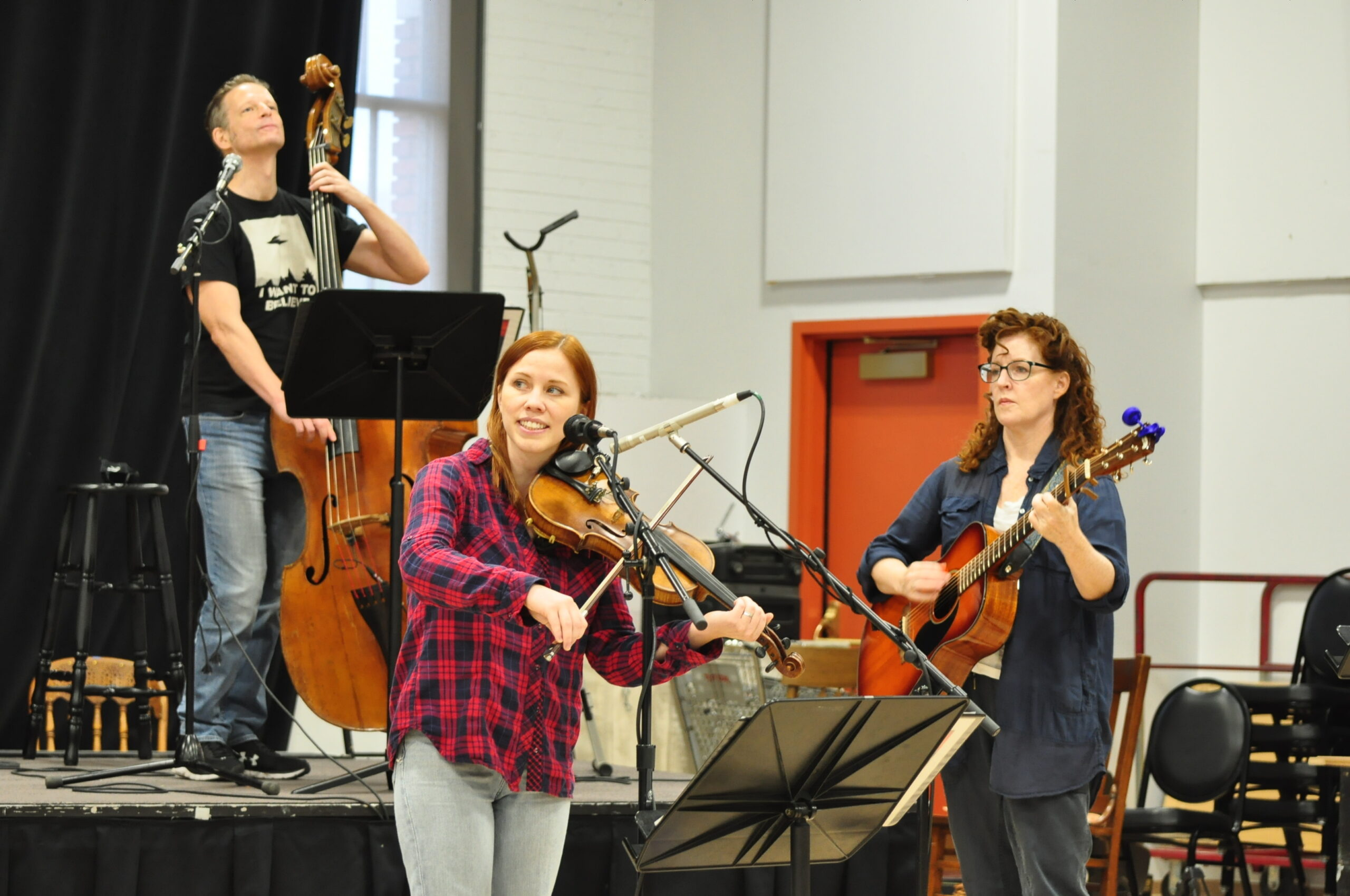 Joe Casey (left), Kendra Jo Brook and Linda Mugleston play during rehearsals for Wild Fire, a new show by the Denver Center for the Performing Arts.