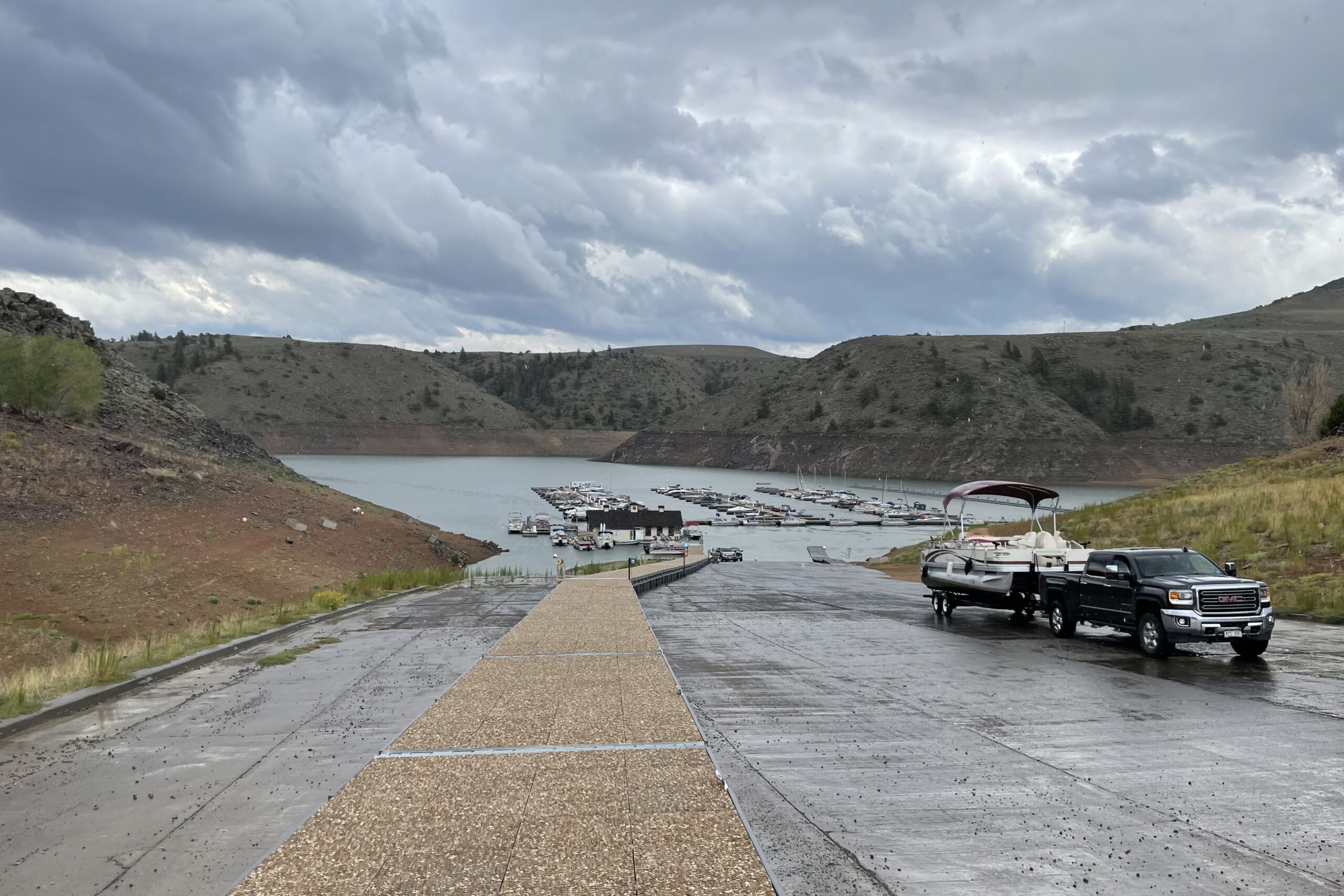A truck hauls a boat up the ramp at Elk Creek Marina at Blue Mesa Reservoir on August 19, 2021.
