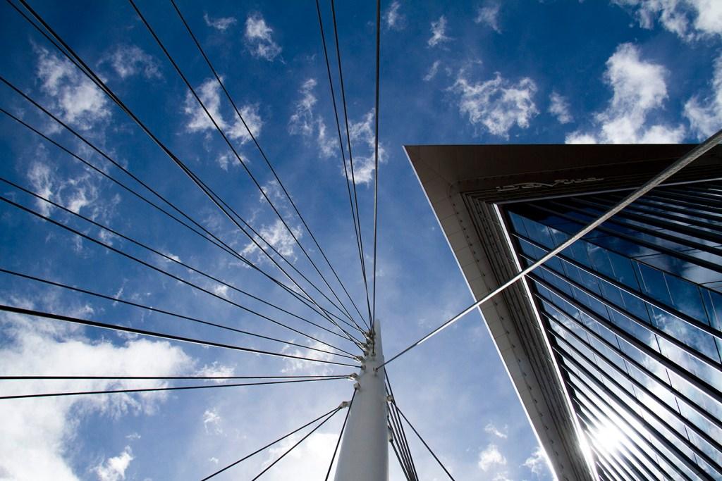 Denver's Mellenium Bridge in LoDo  denver; colorado; mellenium bridge; skyline; building; sky; bridge; downtown; lodo; platte river; clouds; denverite; kevinjbeaty; high rise; apartments; apartment; architecture