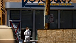 Crime scene investigator locks the door at Rosenberg's Bagels on May 12. (Kevin J. Beaty/Denverite)  rosenberg's; rosenbergs; five points; denverite; denver; colorado; kevinjbeaty